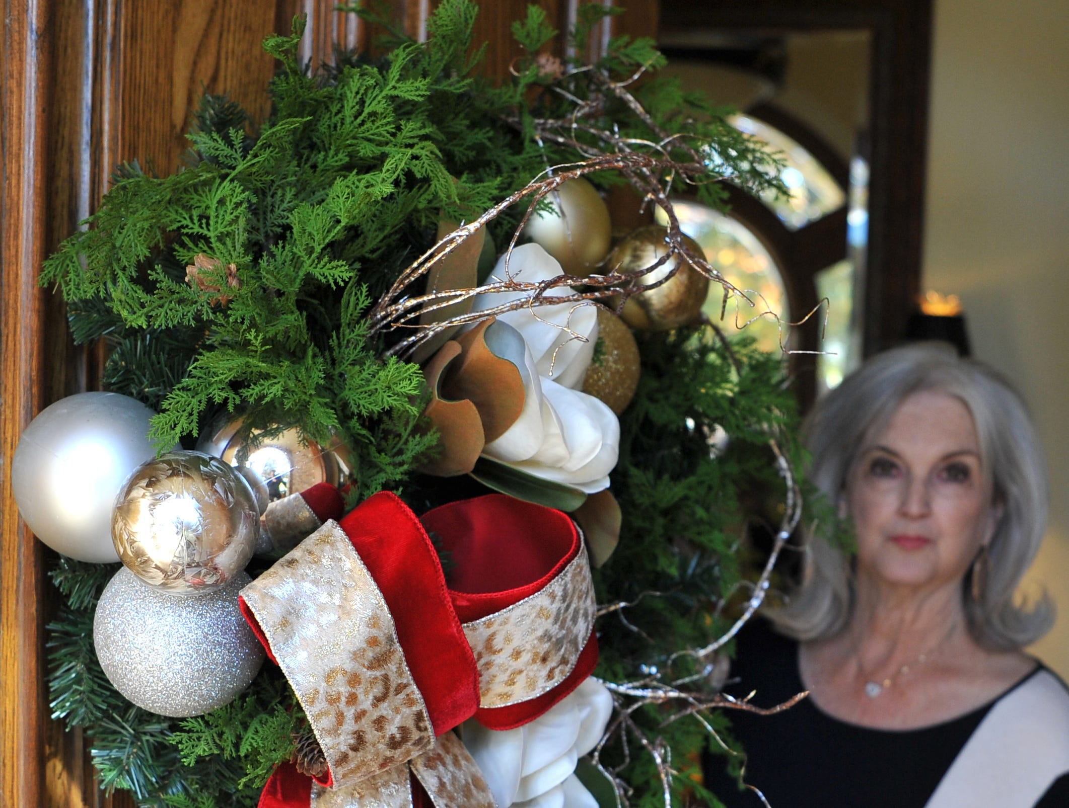 Mary Ann Recht looks at some of her Christmas decorations. The Recht's home will be part of this year's annual Christmas Tour of Homes.