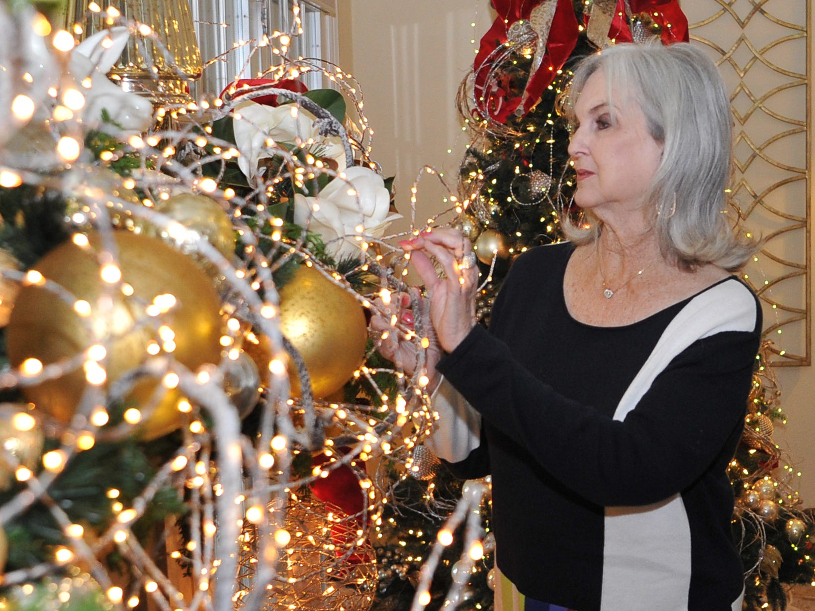 Mary Ann Recht looks at some of her living area Christmas decorations. Recht's home will be part of this year's annual Christmas Tour of Homes.