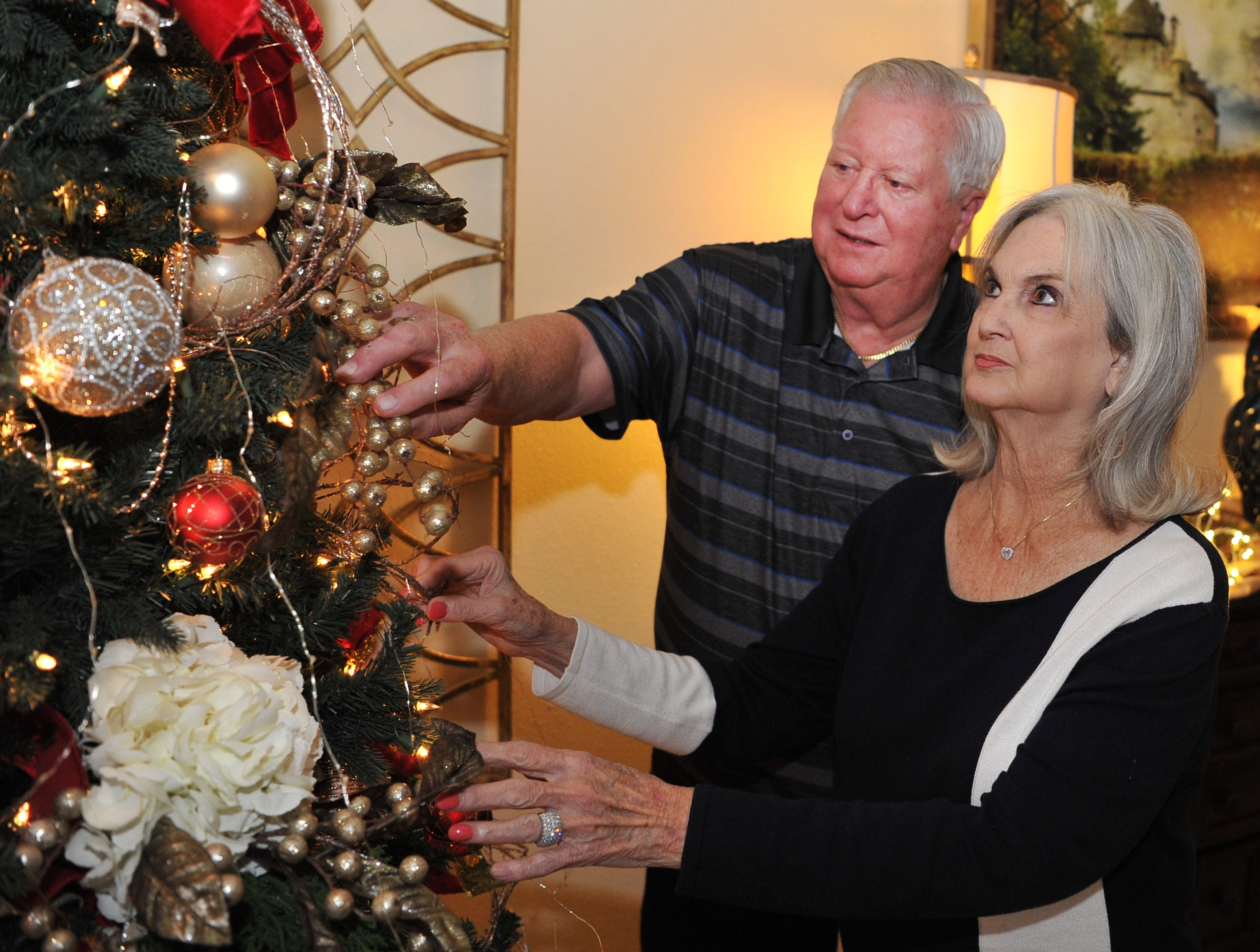Dwight and Mary Ann Recht look at some of their Christmas decorations. Rechts' home will be part of this year's annual Christmas Tour of Homes.