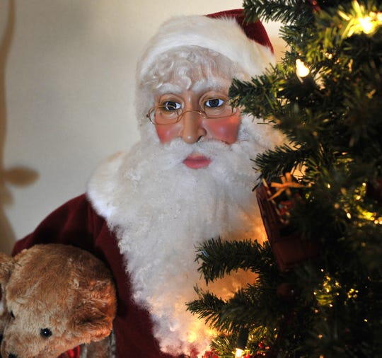 A Santa Claus is one-of-several Christmas decoration that will be displayed at the Rechts' home during the 39th annual Christmas Tour of Homes.