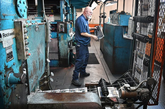 Times Record News pressman Dale Price checks on one of about 20 commercial print jobs that the press prints in addition to the TRN, and recently, the San Angelo Standard-Times and the Abilene Reporter-News.