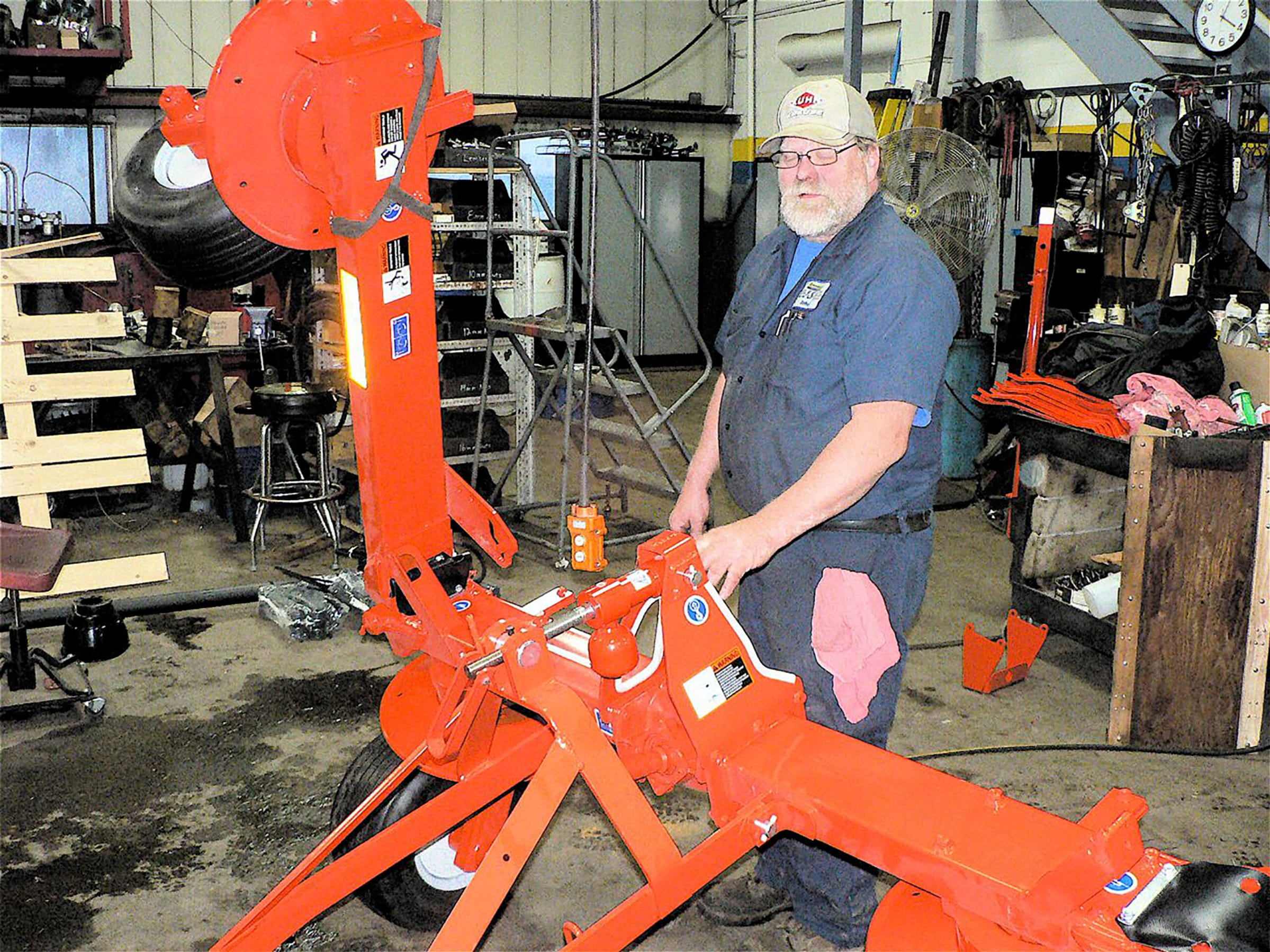 John Pomerenke assembles a hay tool.