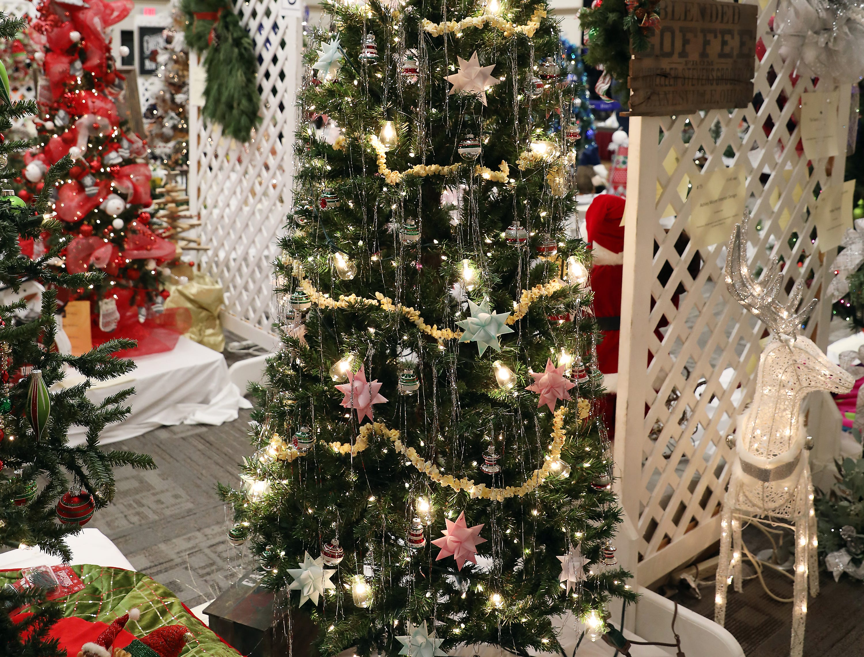 1964:45 PMAmerican Ear HearingLarge TreeTree of YesteryearLarge tree with clear lights, nostalgic,  40s-esque Christmas tree adorned with handmade paper ornaments and stringed popcorn.1 Starkey muse iq i2400 Receiver- In- Canal hearing aid and all test, dispensing and follow up fees