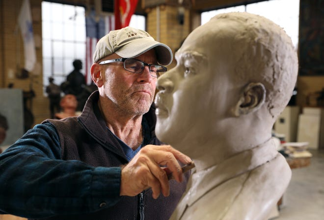 Sculptor Alan Cottrill works on a bust in his studio in downtown Zanesville.