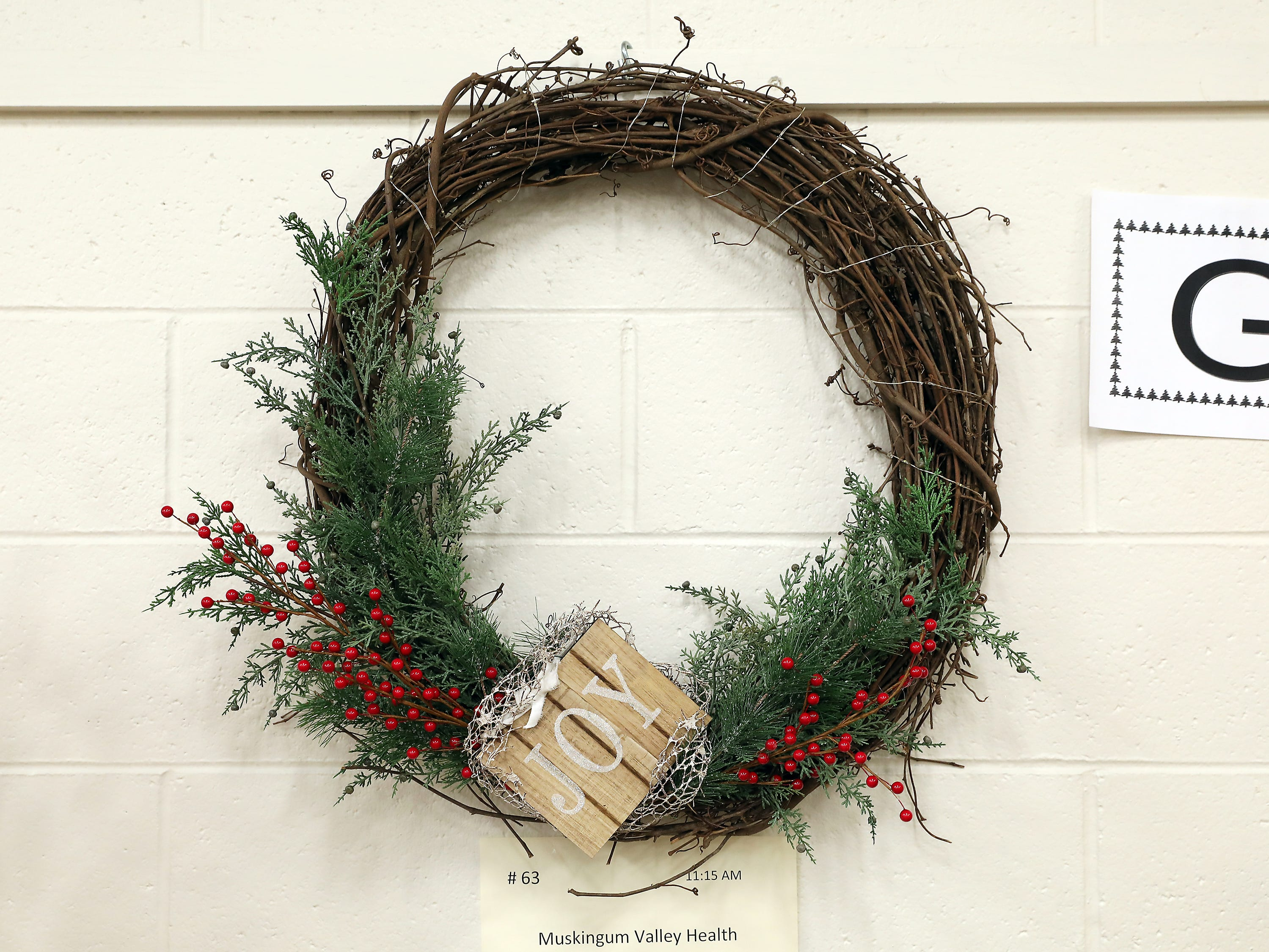 63	11:15 AM	Muskingum Valley Health Centers	Wreath	Joyful Christmas	A rustic lighted Christmas wreath		$100 gift card to VinAmi Wine Bar and Bistro, Downtown Zanesville.