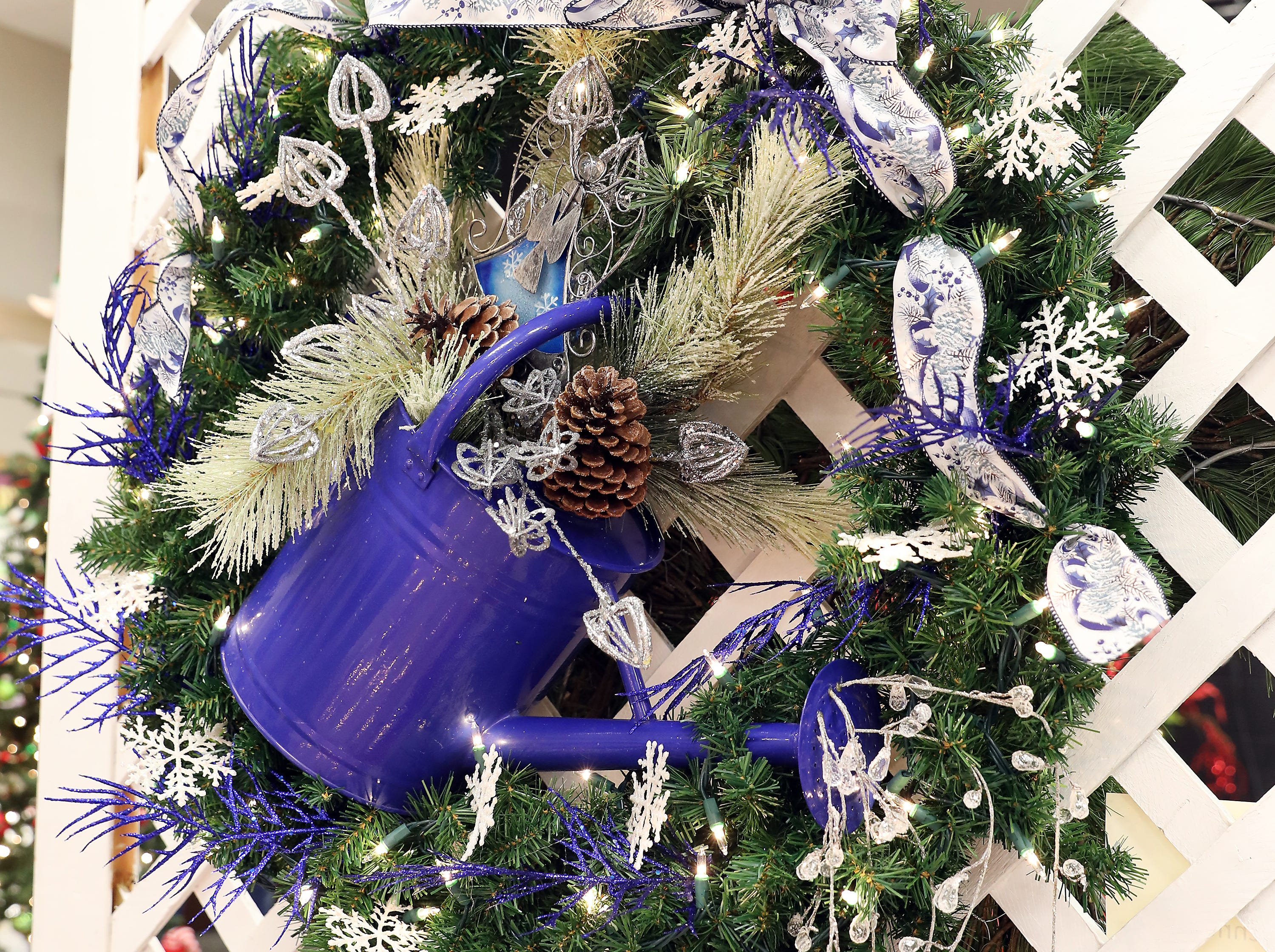 "135	2:15 PM	Muskingum Valley Garden Society	Wreath	Garden Beautiful 	A green pine wreath accented with blue and white.  Large blue tin watering can in the center of the wreath.		4 tickets to attend the ""Spring Fling Garden Symposium"" and 3 garden books."