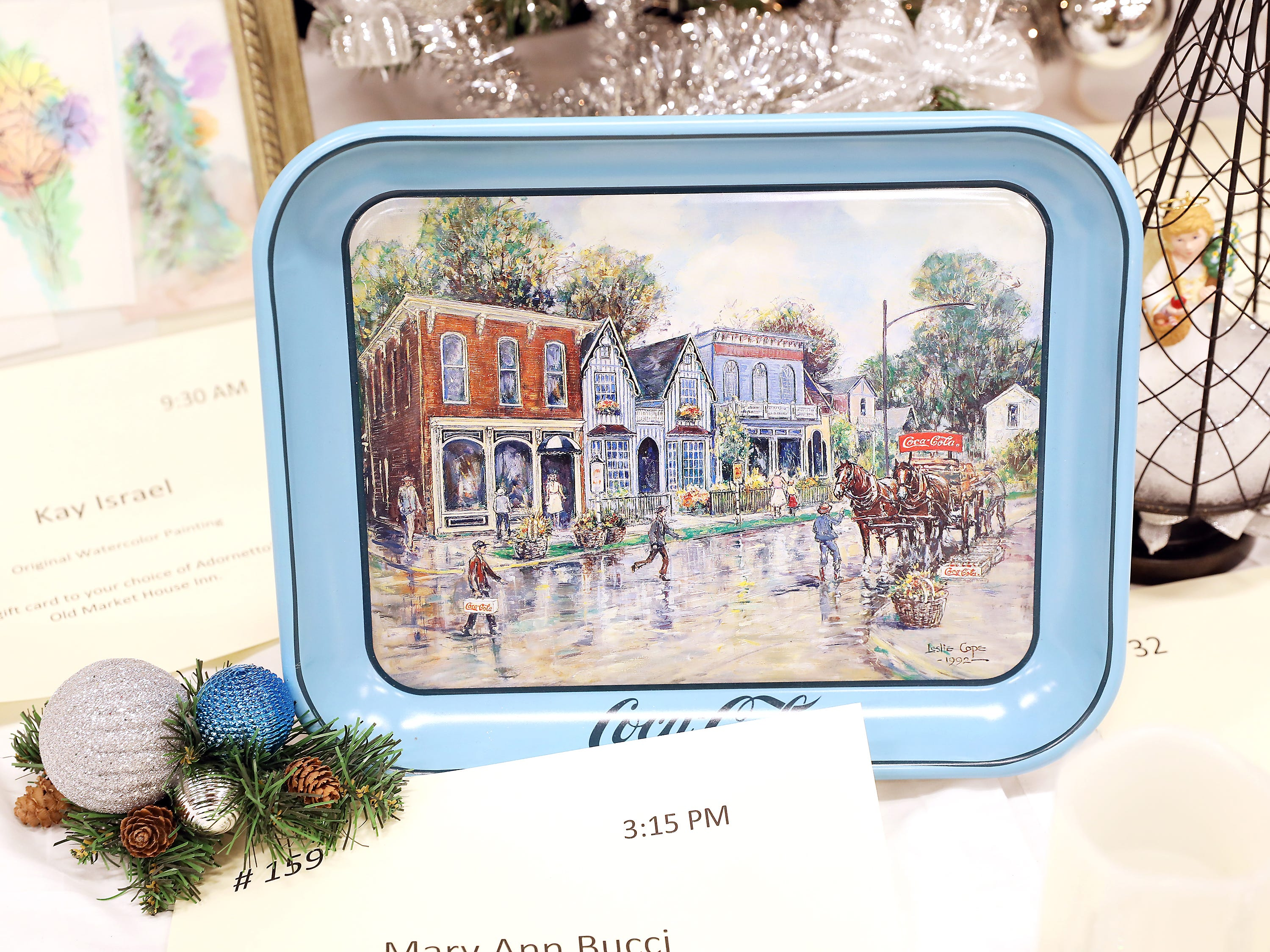 1593:15 PMMary Ann BucciOtherAll-American HometownA Leslie Cope Coca Cola 1992 serving tray featuring Dresden All-American Hometown.  Spring and Summer paintings of the Patio Shops in Dresden by Mary Ann Bucci.