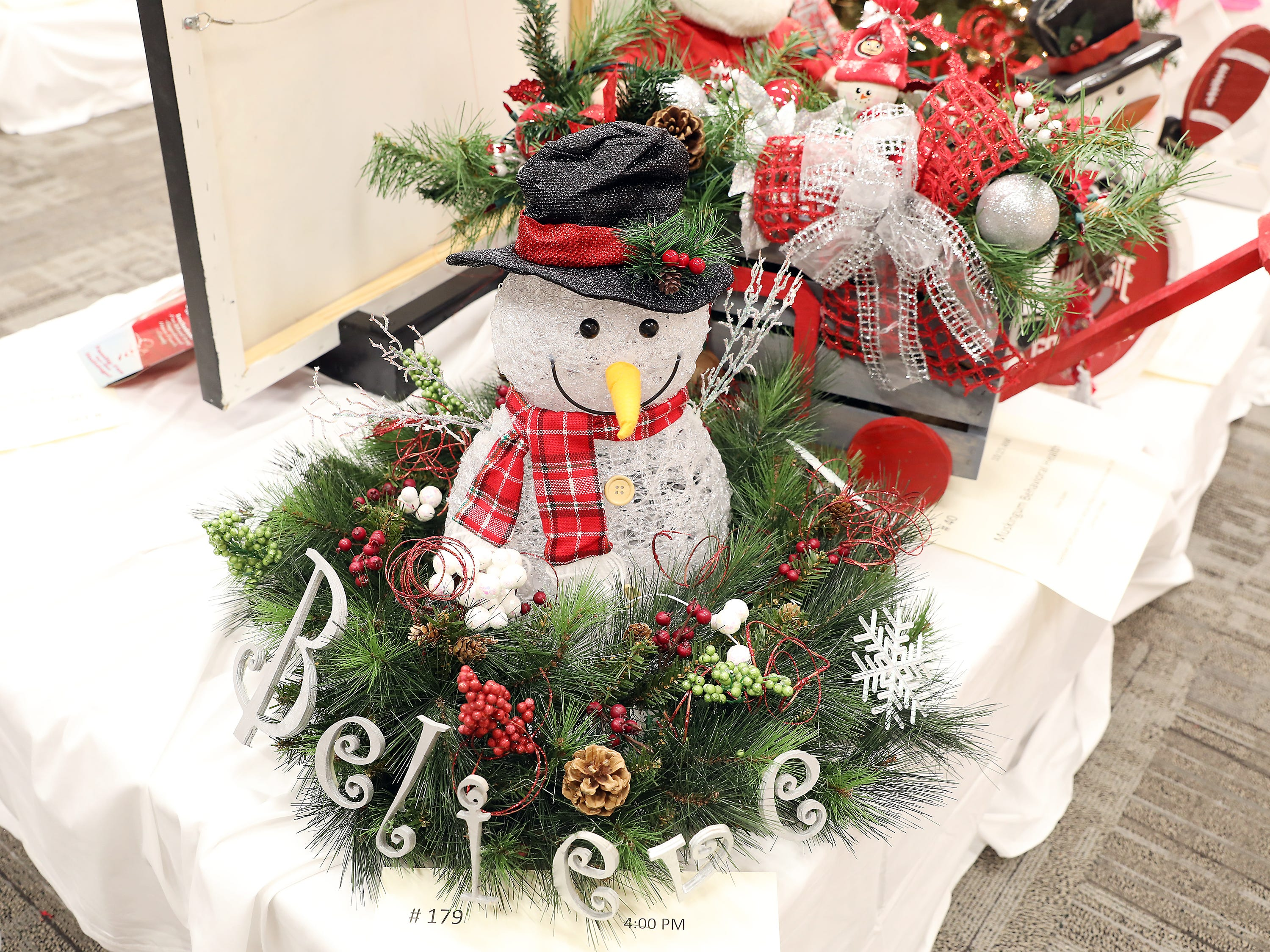 """1794:00 PMPeoples BankCenterpieceFrosty Magical Silent Night TourVibrant """"Frosty"""" centerpiece donned with festive holiday cheer!2 tickets to the """"The Not So Silent Night Tour"""" starring country music artist Phil Vassar and Lonestar at the Peoples Bank Theater on Wednesday, December 19, 2018 at 8:00pm"""