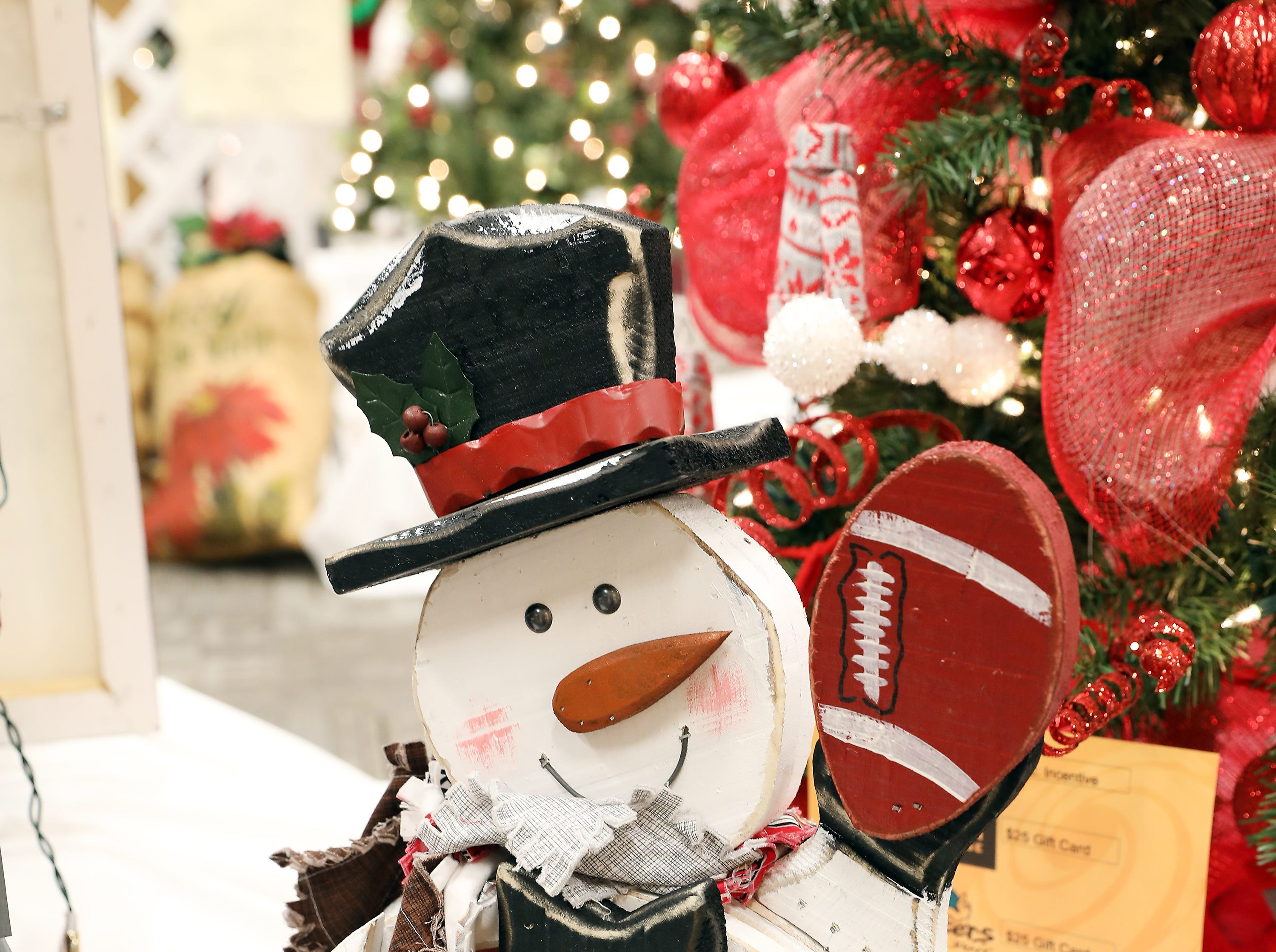1663:30 PMThe Forker CompanyOtherBuckeye SnowmanOSU wooden snowman with patchwork scarf.Ohio Stadium Tour.  A Behind the scenes tour of the Shoe!  Up to 10 people, tour lasts about 1 1/2 hours.