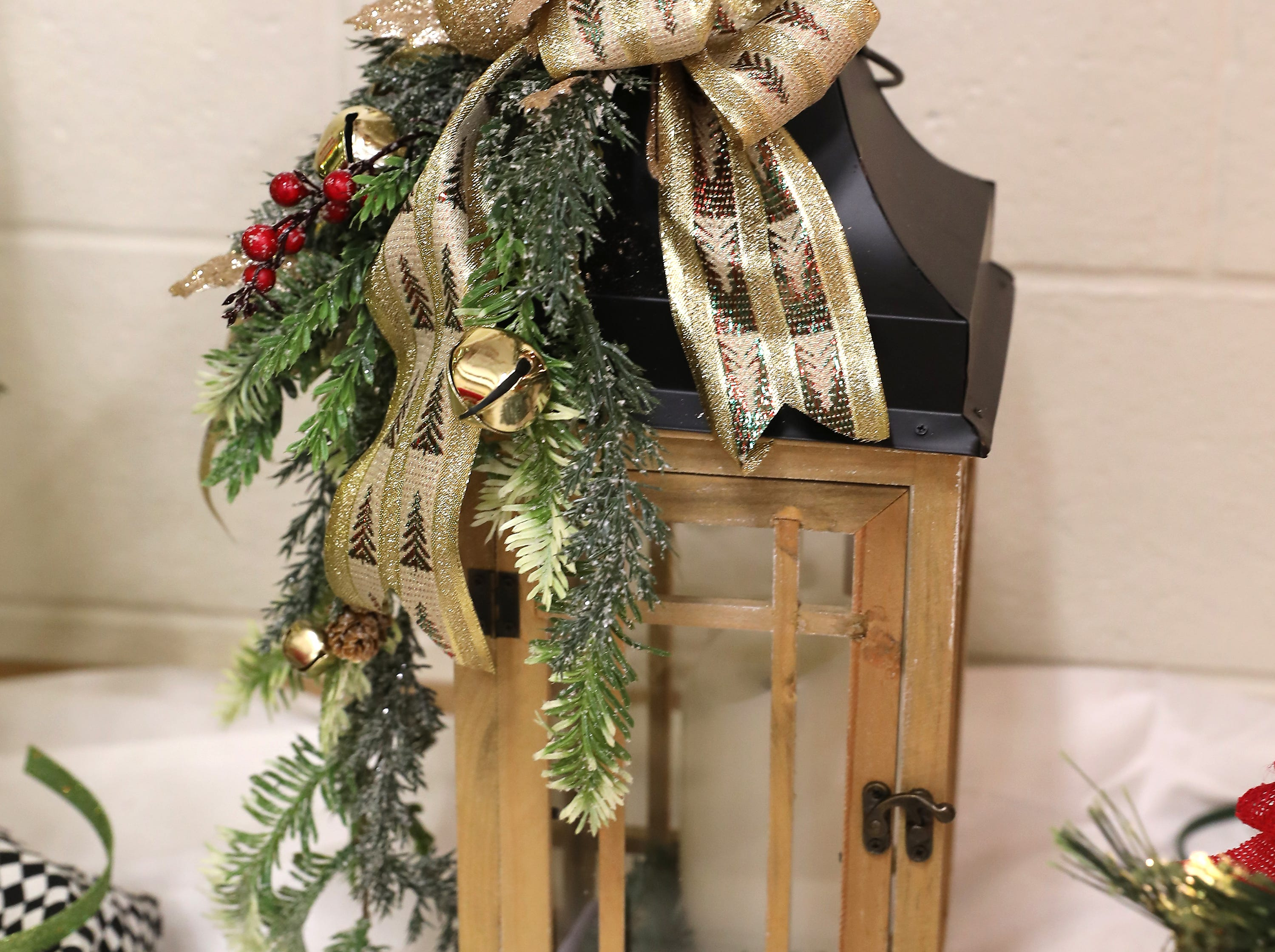 "38	10:15 AM	Home Instead Senior Care	Other	Woodland Lantern	Beautiful 22"" wooden and metal lantern with battery operated candle designed by Susie's Favorites.		$50 gift card to your choice of Adornetto's, Giacomo's, Old Market House Inn."