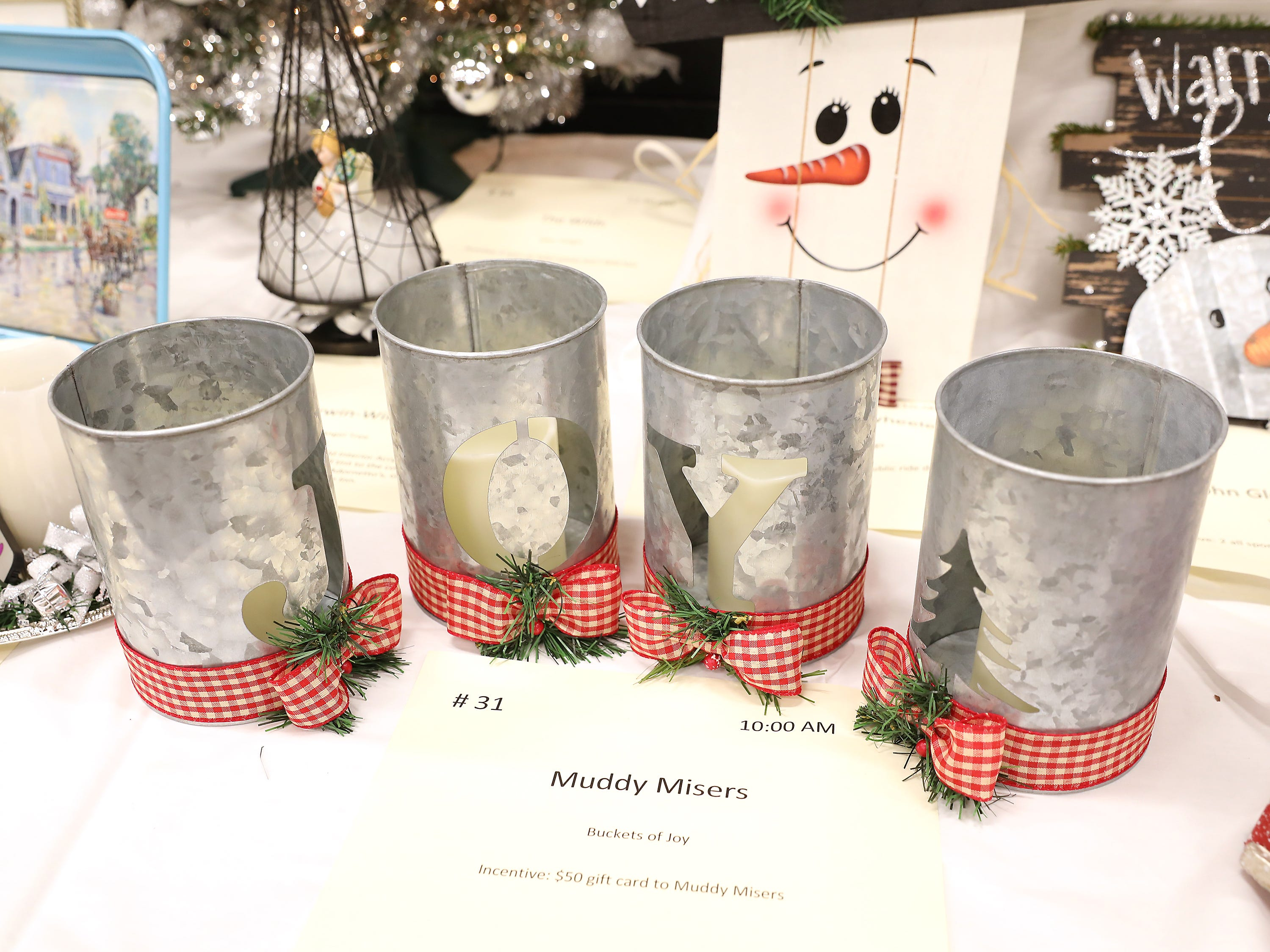 31	10:00 AM	Muddy Misers	Other	Buckets of Joy	A 4 piece galvanized holiday bucket.  Each bucket cutout spelling joy, along with a tree.  Base of the buckets are wrapped in plaid ribbon and pine.		$50 gift card to Muddy Misers