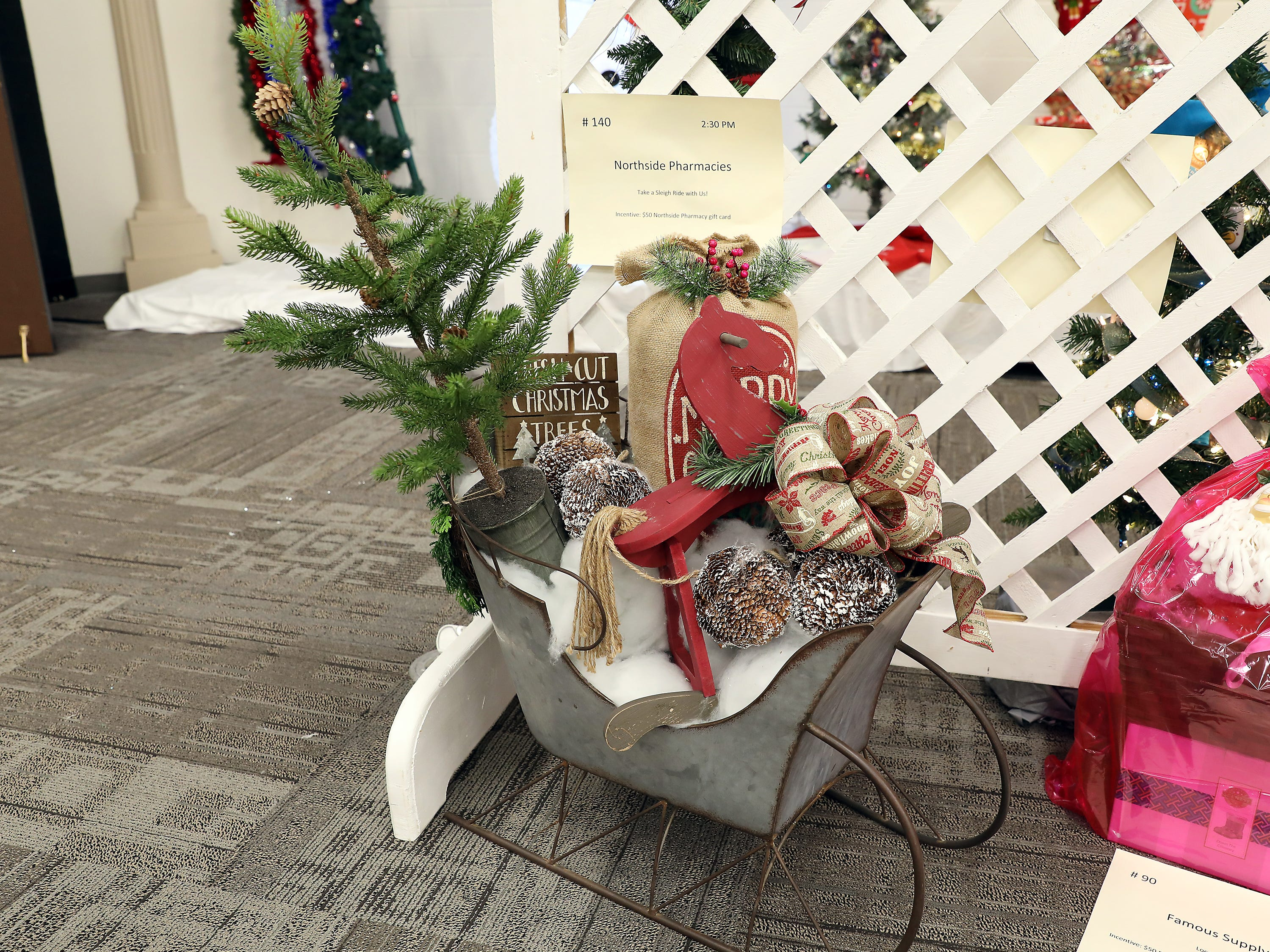140	2:30 PM	Northside Pharmacies	Other	Take a Sleigh Ride with Us!	Metal sleigh filled with holiday décor.		$50 Northside Pharmacy gift card