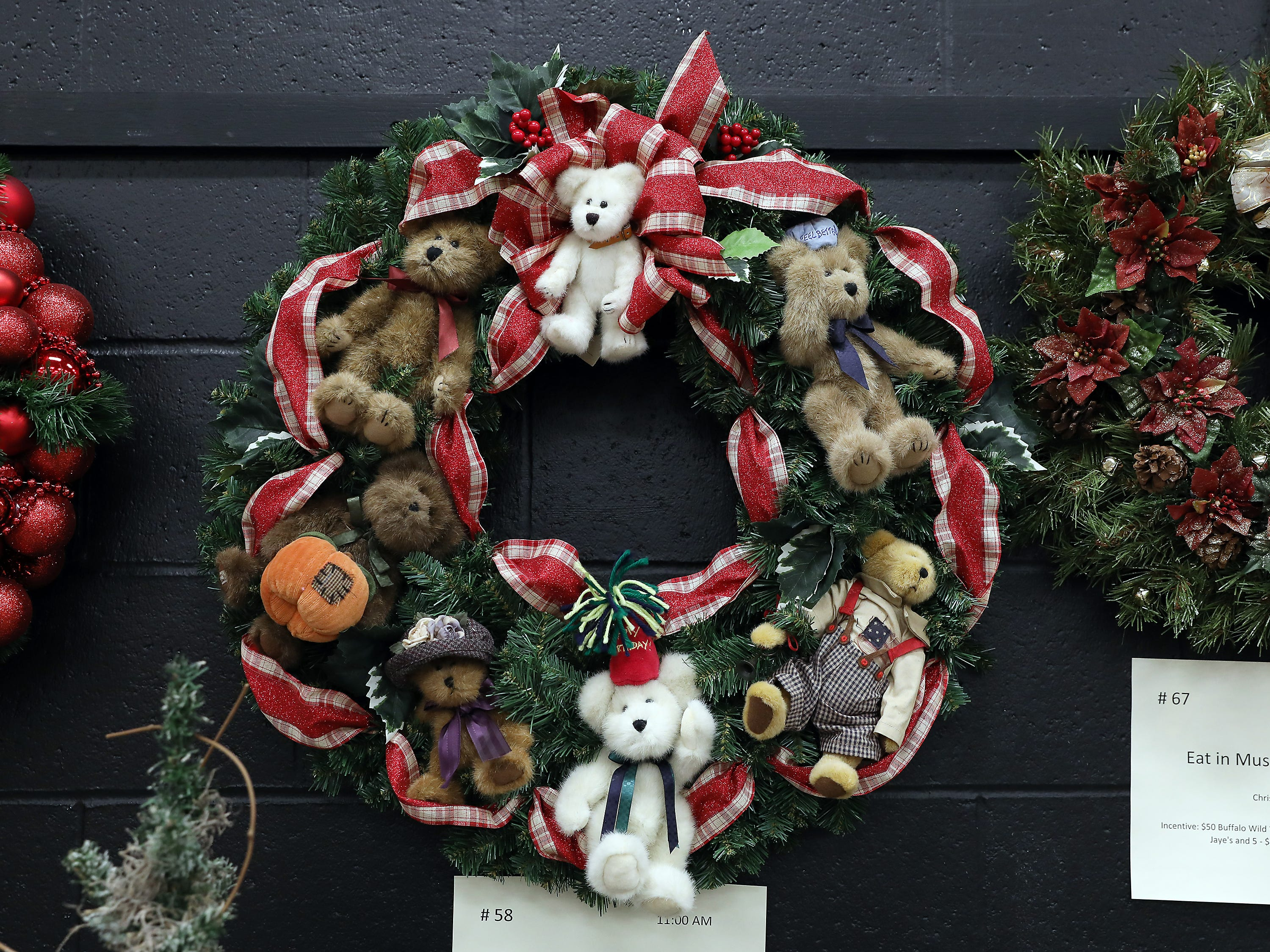 "58	11:00 AM	Committee Entry	Wreath	A Boyds Bear Christmas	A 28"" Boyds Bear wreath decorated with 7 collectible Boyds Bears with tags.  Adorned with Christmas holly and ribbon		1 large collectible Boyds Bear, $50 gift card to your choice Adornetto's, Giacomo's, Old Market House Inn."