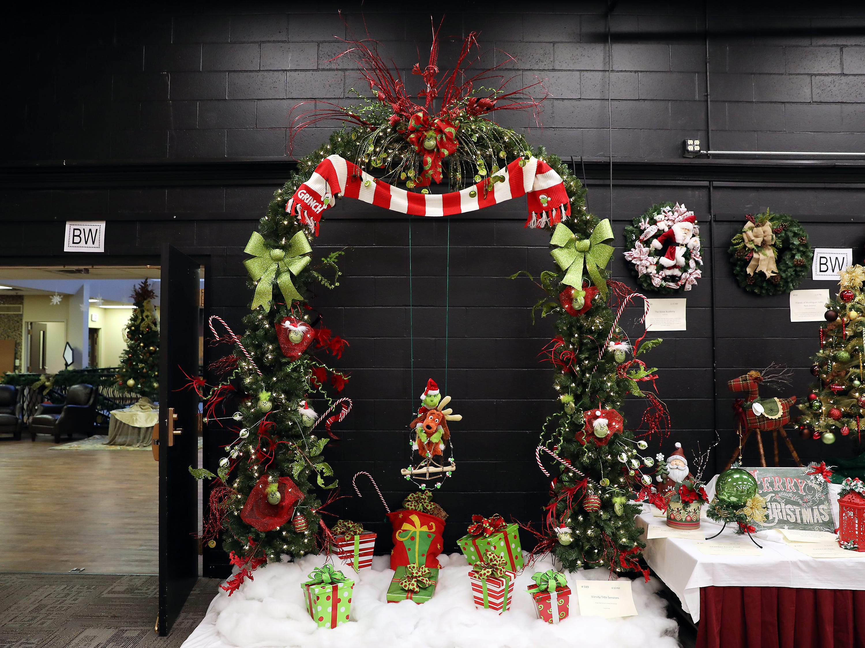 1894:30 PMVarsity Title ServicesLarge TreeHow the Grinch Stole Christmas9' pre-lit fir tree archway with a Grinch theme and the Grinch and Max sitting on a swing in the middle.16x20 autograph Zack Boren domination photo and other assorted OSU football photos.