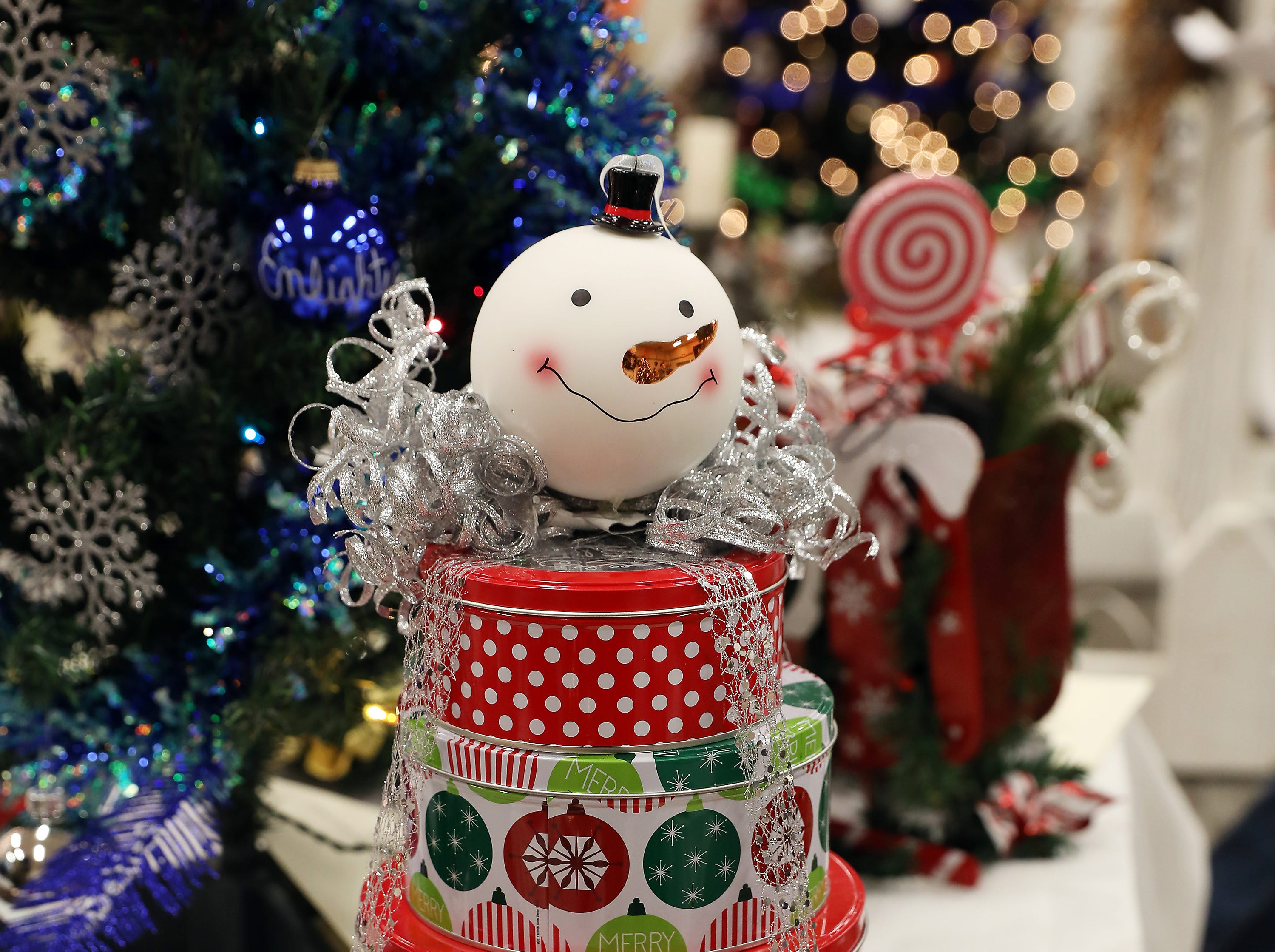 "57	11:00 AM	City of Zanesville - City Treasurer	Other	Zanesville is a ""tree""mendous place to call home!	4 to 5 tier boxes in a shape of a Christmas tree.		$20 Adornetto's gift card, $20 Zak's gift card, 1lb cashews, 1lb red skins and 1 1/2lb assort. Chocolate from Tom's Ice Cream Bowl and individual bags of Conn's Potato Chips."