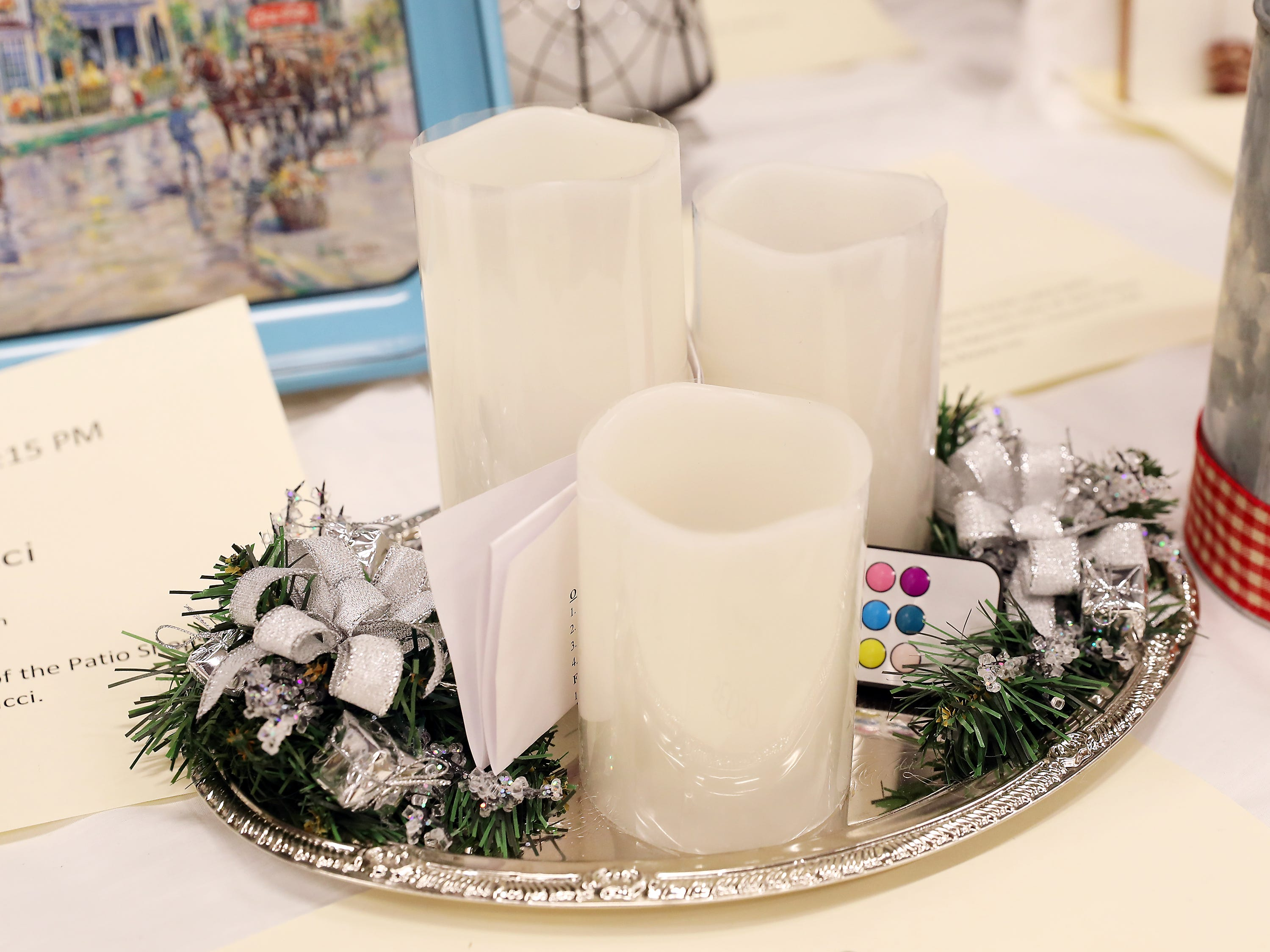 71	11:30 AM	SEOSO	Centerpiece	Winter Glow	3 battery operated candles on timers sitting on a silver tray with packages, pine and ribbon		SEOSO CD and 2 season tickets for the 2019 SEOSO season.