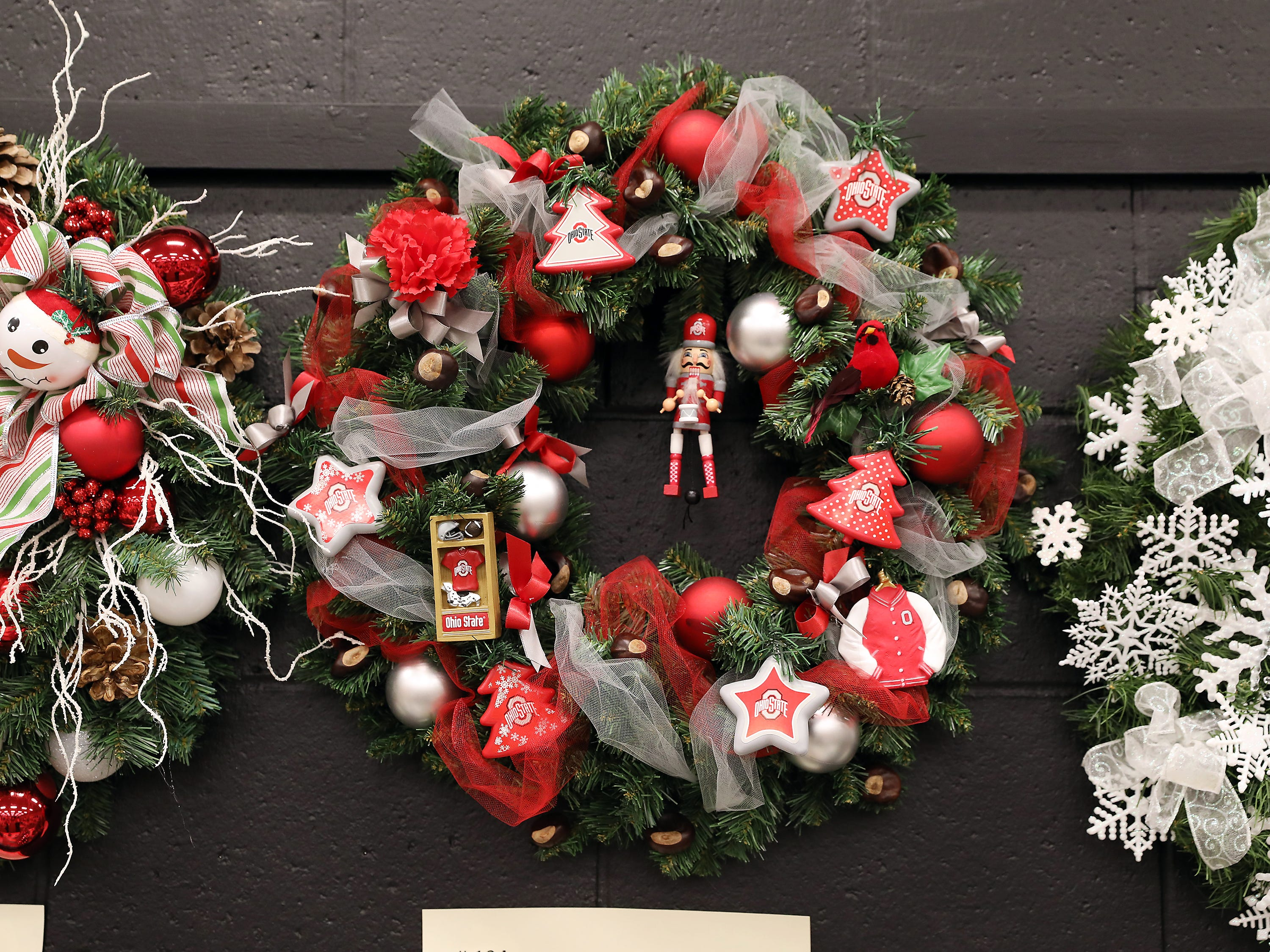 """1944:45 PMBryan Graham - Dutro FordWreathGo Bucks!24"""" green wreath decorated in full OSU, perfect for any Ohio State fan!4 tickets to Ohio State Men's Basketball, December 18, 2019.  OSU vs. Youngstown State.  Huntington Club level seating, parking pass included."""