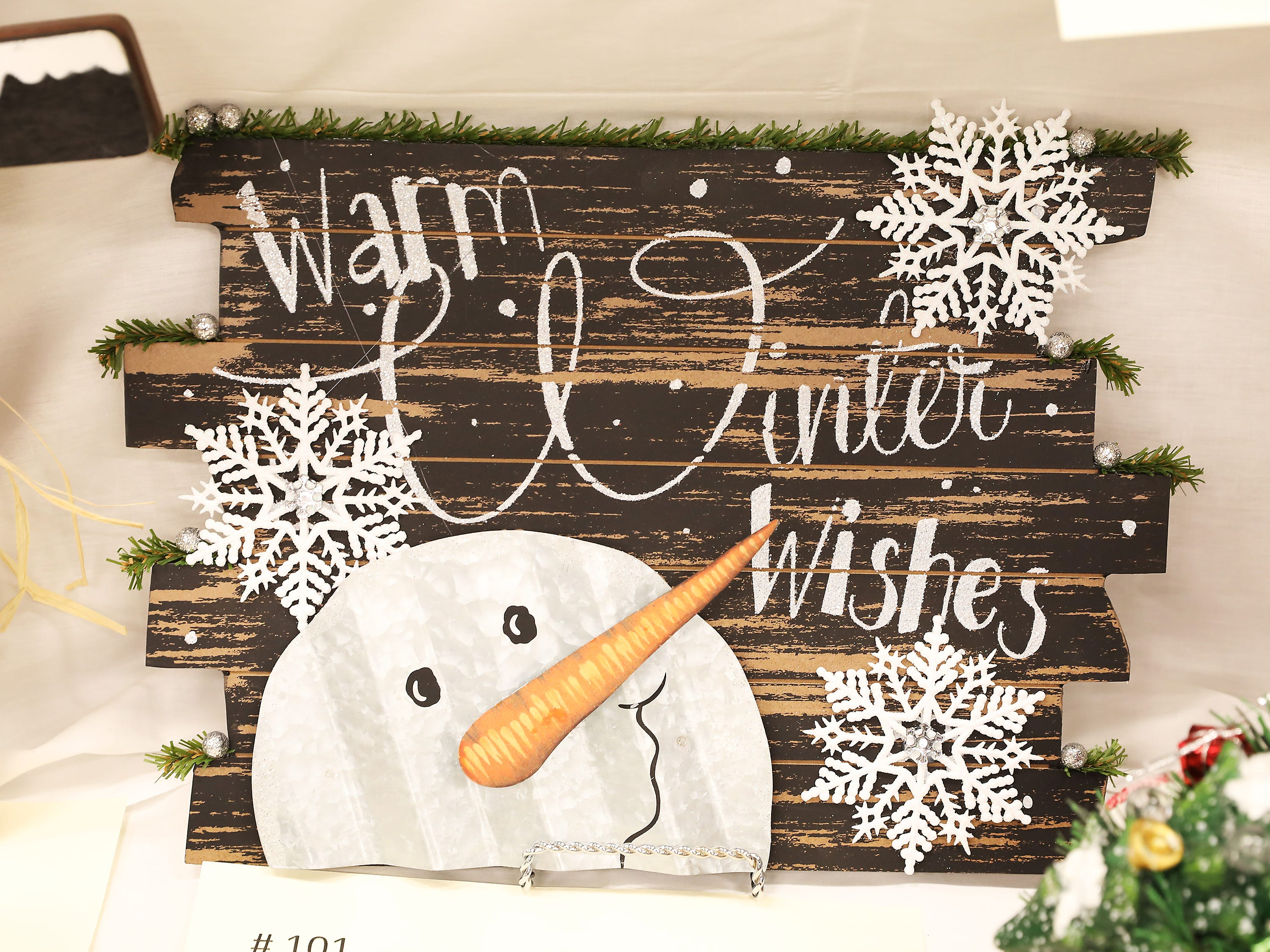"101	1:00 PM	John Glenn High School	Other	Warm Winter Wishes	This beautiful 16""x11"" Warm Winter Wishes sign features a metal snowman, white snowflakes and paneled wood with a distressed and rustic finish.  		2 all sport passes for the 2018-2019 school year.  Go Muskies!"