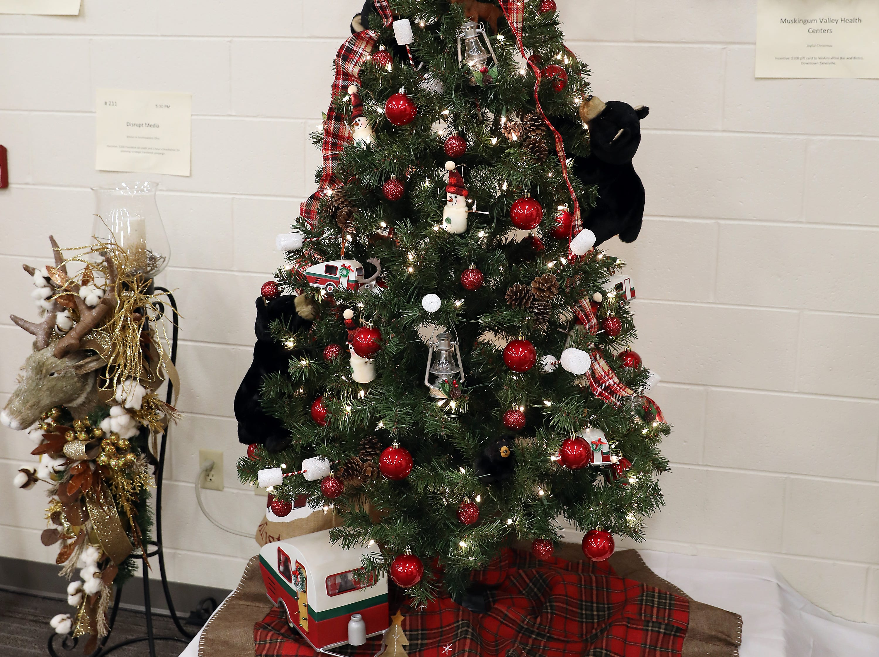 153	3:00 PM	Carr Center	Large Tree	I'll be Camping for Christmas	Rustic, woodland inspired 6' pre-lite Alberta Spouse tree with clear lights decorated with a camping theme and forest creatures.		$50 Ohio State Park gift card, including little cuddly black bears.