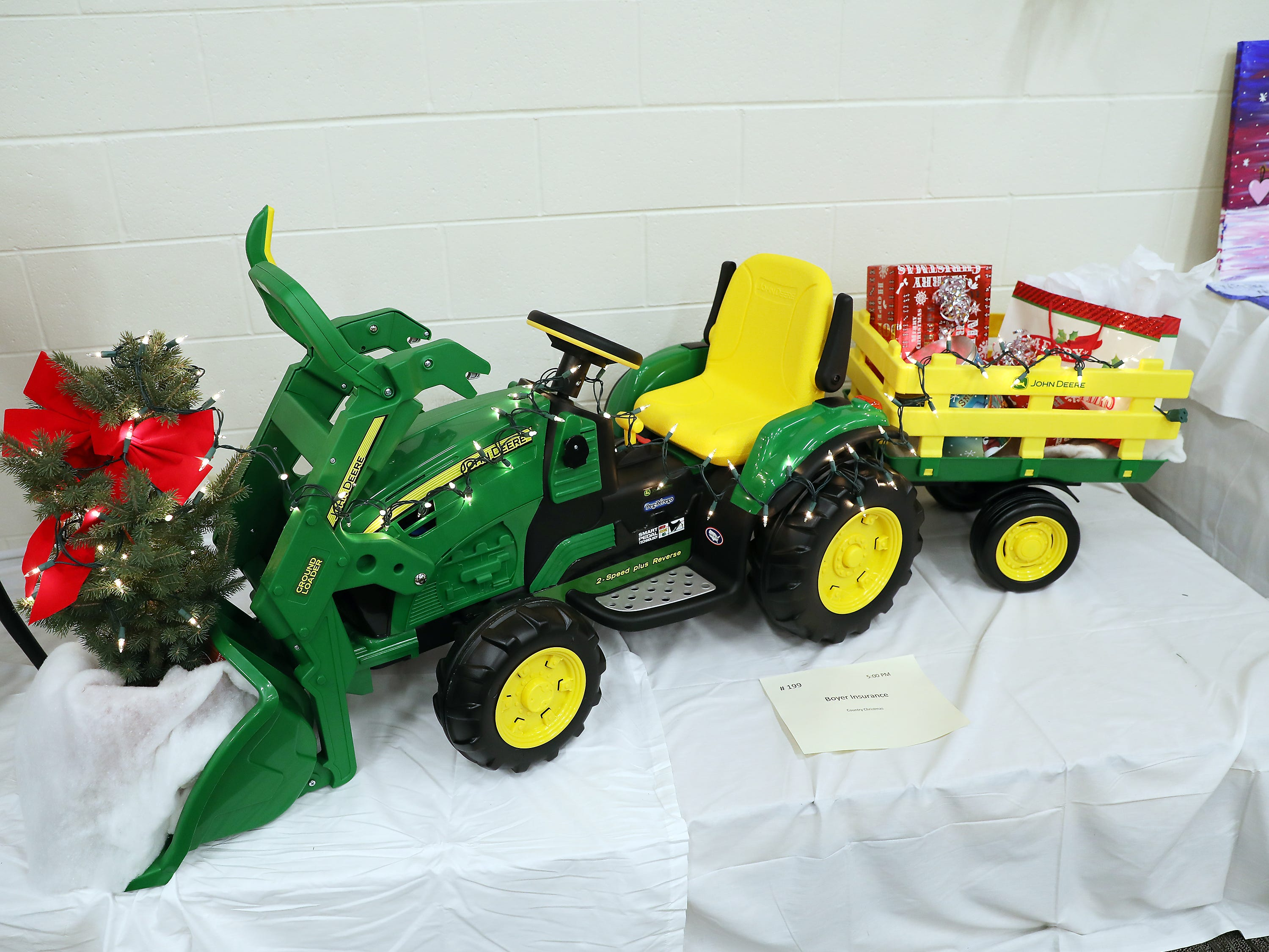 1995:00 PMBoyer InsuranceOtherCountry ChristmasA John Deere battery powered tactor with wagon and bucket!Entry is incentive.