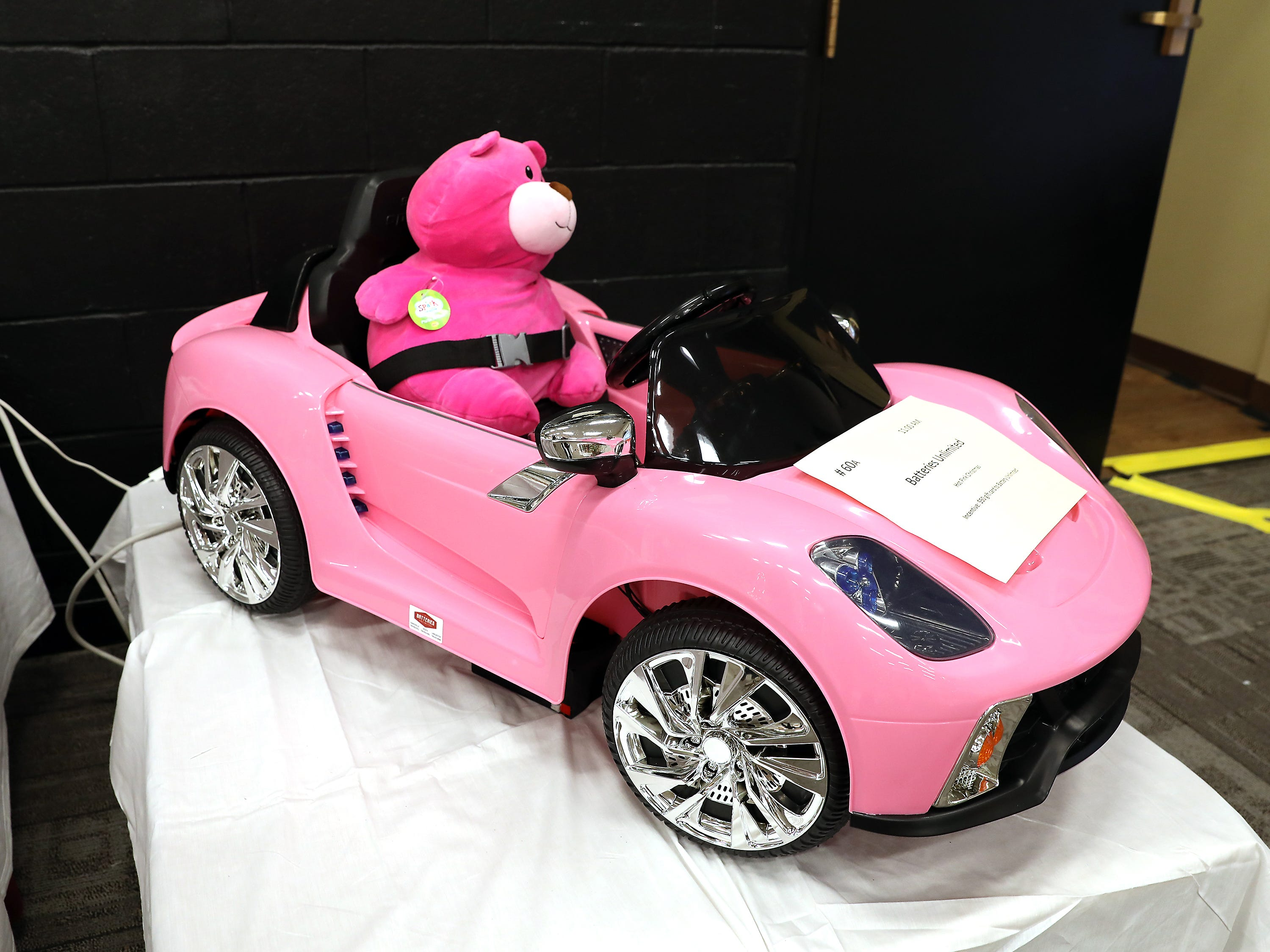 60A	11:00 AM	Batteries Unlimited	Other	Hot Pink Christmas	A hot pink powerwheel car with a large pink teddy bear. 		$50 gift card to Batteries Unlimited