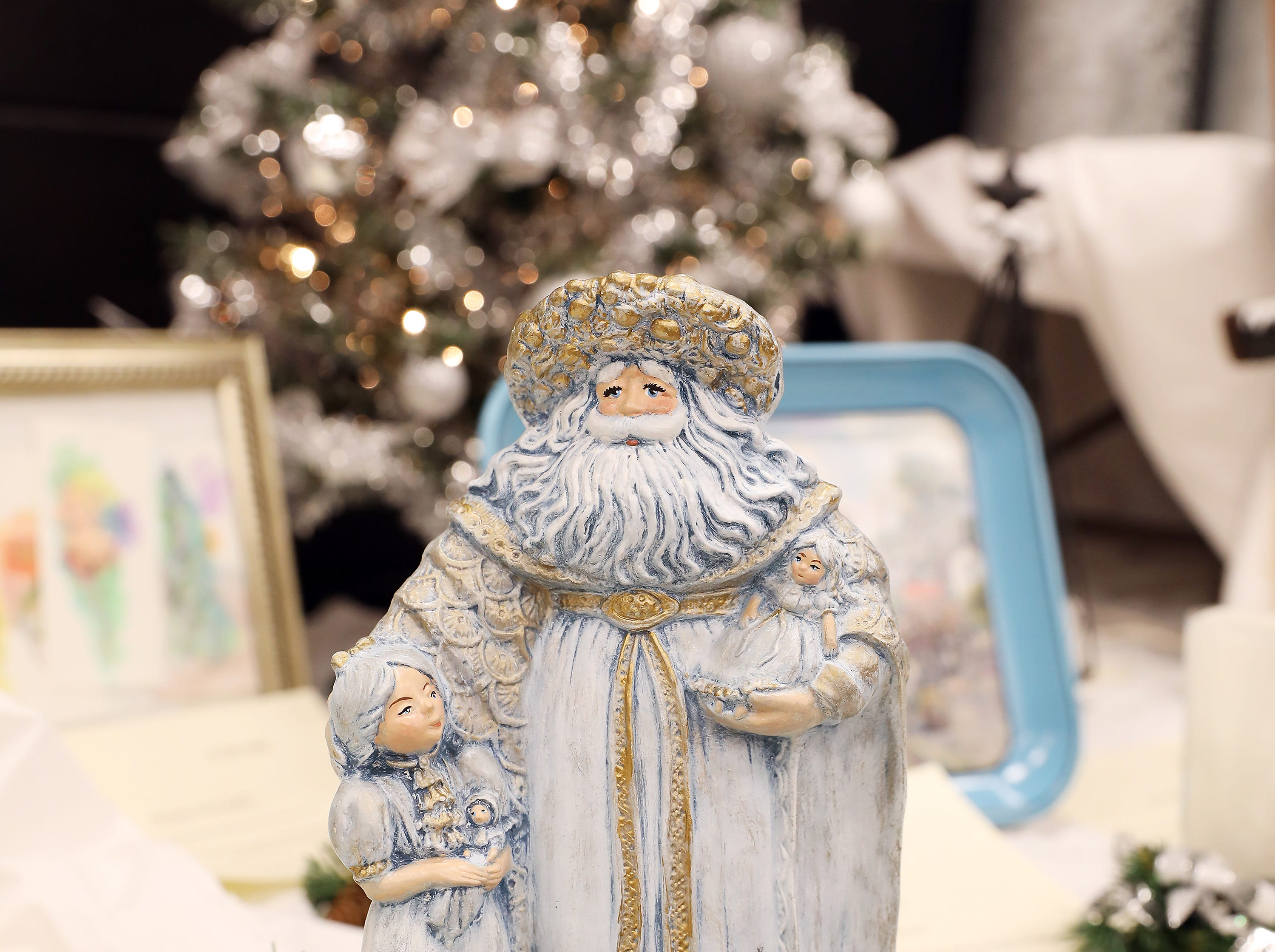 """1834:15 PMHoneyBaked HamOtherOld Saint NicholasA 15"""" tall Old Saint Nicholas dressed in his winter blues, accompained by a small child, with green pine, gold ribbon, gold bulbs and mini packages.8lb Bone In Ham"""