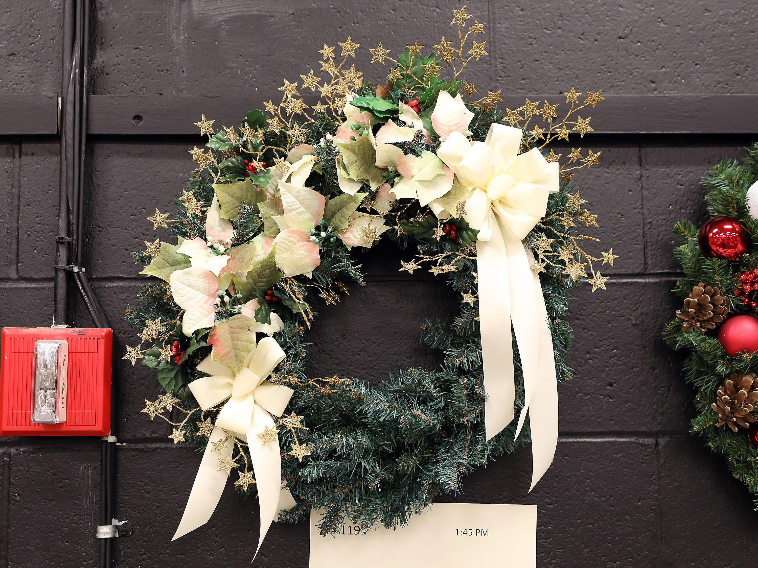 "119	1:45 PM	Mary Ann Bucci	Wreath	This Season	20"" green pine wreath decorated with ivory poinsettia and gold trim.		Fall and Winter paintings of the Patio Shops in Dresden by Mary Ann Bucci."