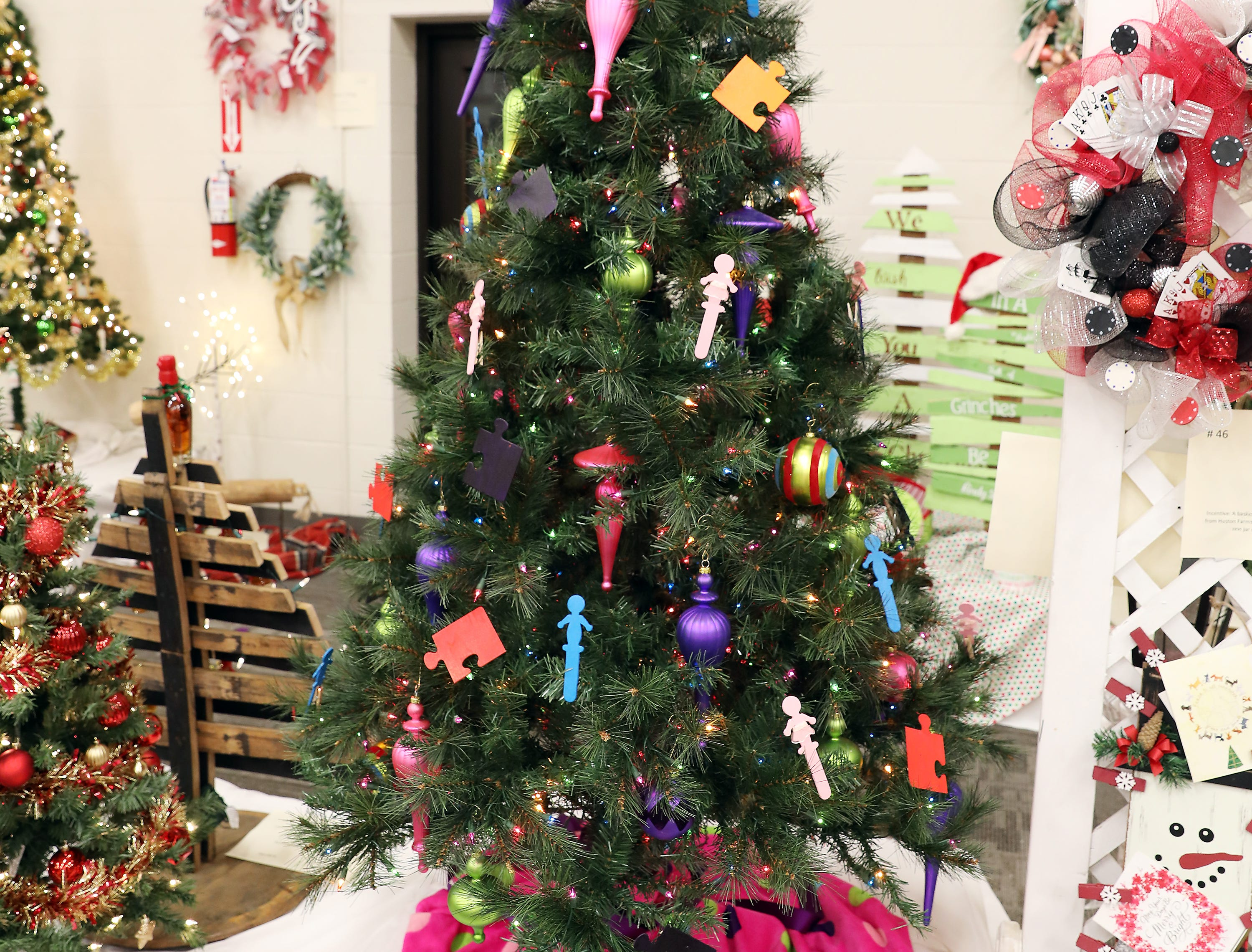 2005:00 PMCoconis FurnitureLarge TreeA Merry Christmas for Children with AutismLarge tree with striped hat as a topper, large glass ornaments in bright colors, hand painted puzzle pieces and children ornaments.$250 gift card to Coconis Furniture