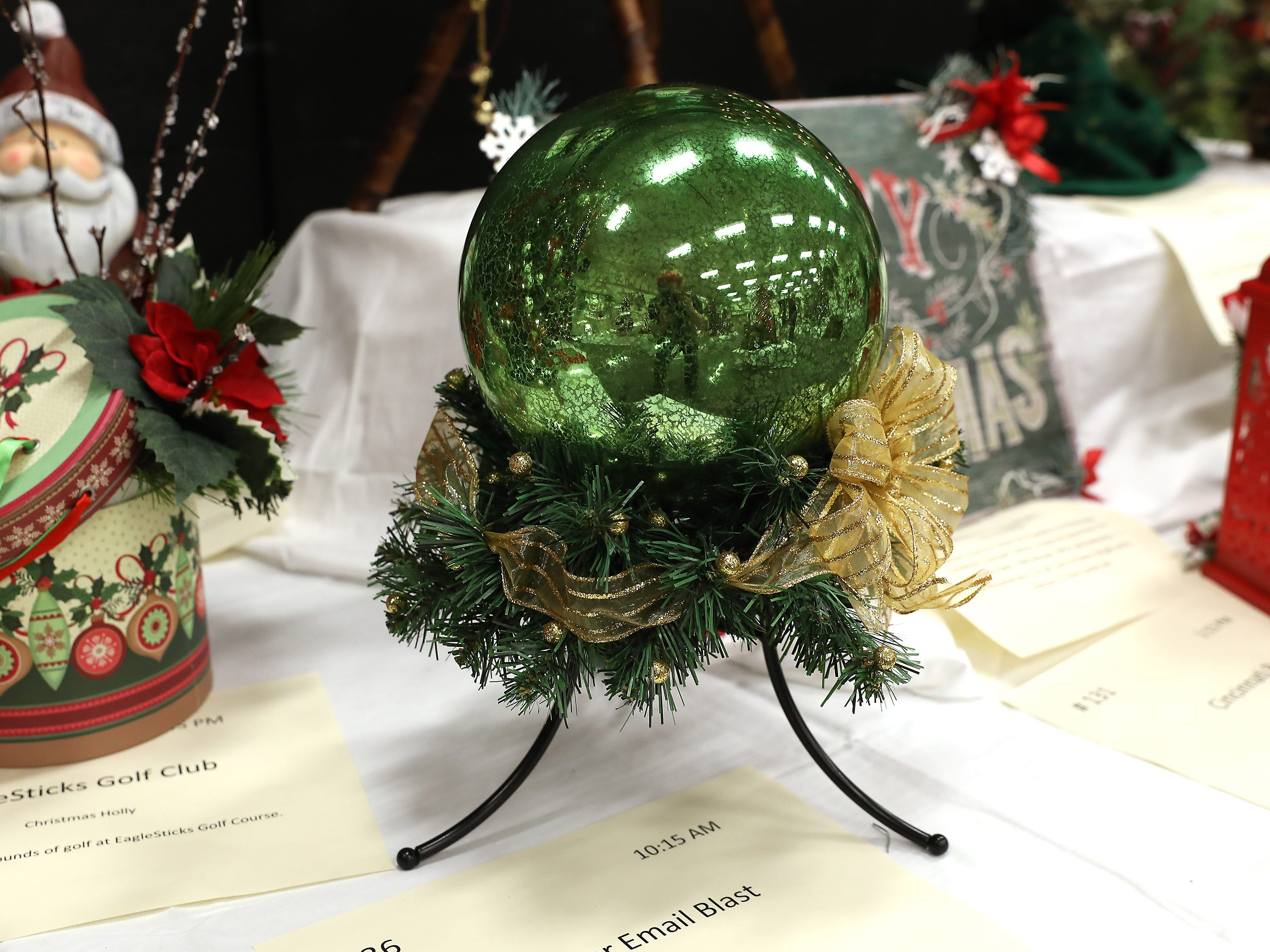 36	10:15 AM	Chamber Email Blast	Other	A Christmas Ball	A large lighted crystal green glass ball, surrounded with green pine and gold ribbon.  Accompanied with black stand.		2 Chamber email blast for 2019