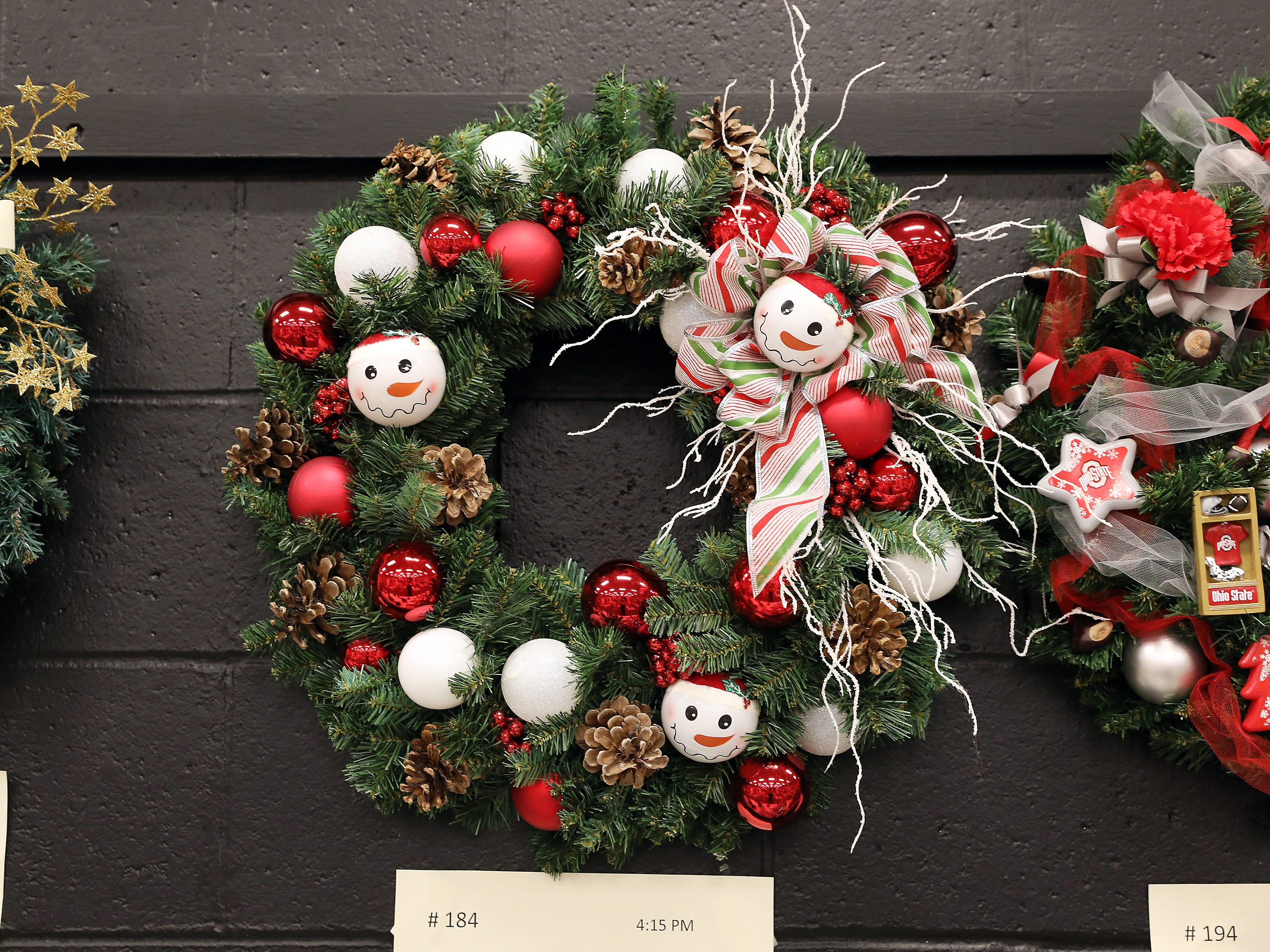 """1844:15 PMItalian Eatery Picnic PizzaWreathSnowball Fun!18"""" Christmas pine wreath decorated with white, red, snowmen bulbs, pine cones, winter branches and ribbon.1 large, 1 item pizza per month for the year of 2019."""
