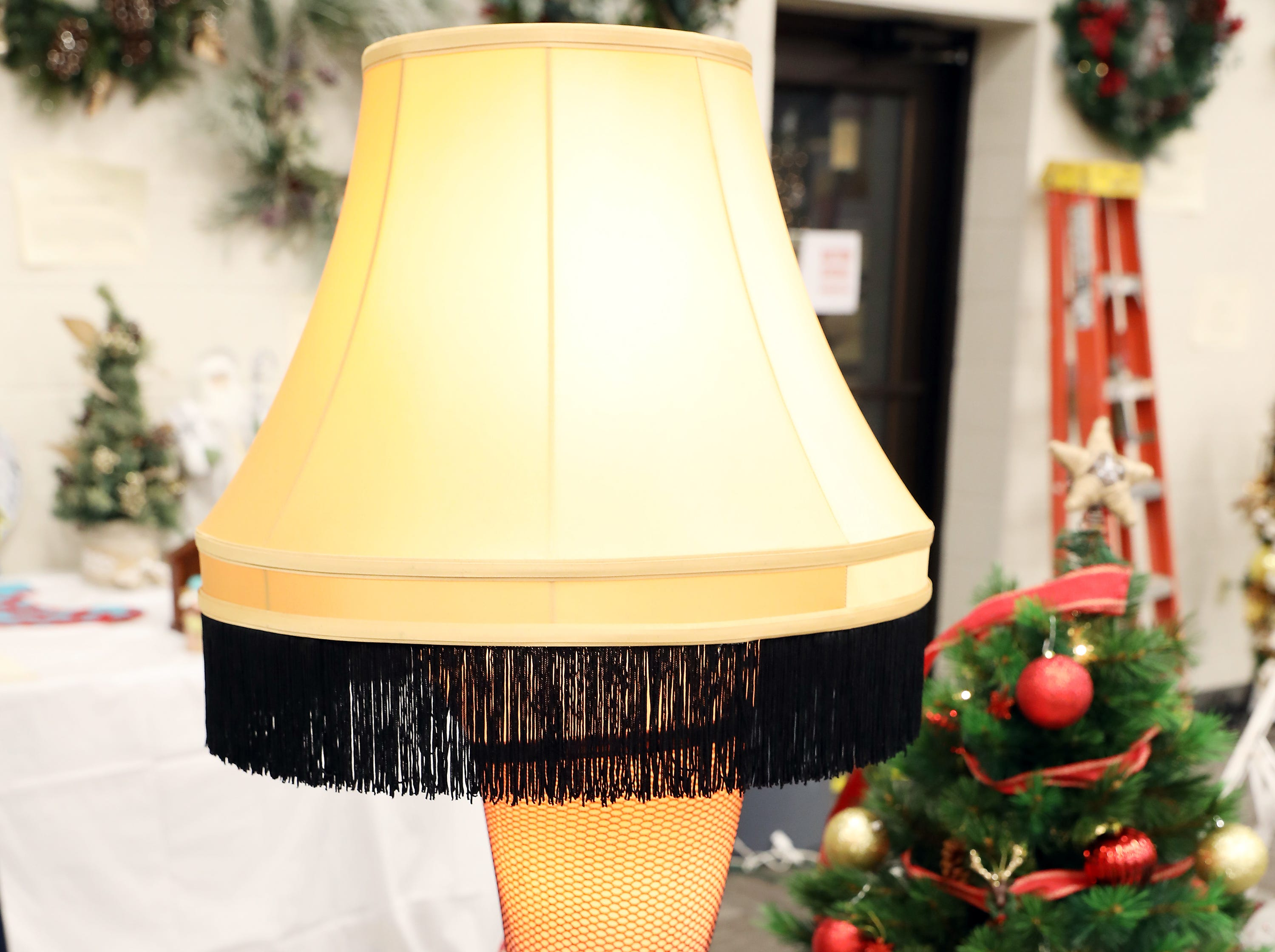 """1683:30 PMY City RealtyOtherA Christmas StoryA Christmas Story 50"""" deluxe full size leg lamp.A Christmas Story DVD, 2 adults, 2 child admission tickets for A Christmas Story House and Museum in Cleveland along with an original bar of A Christmas Story Lifebuoy Soap."""