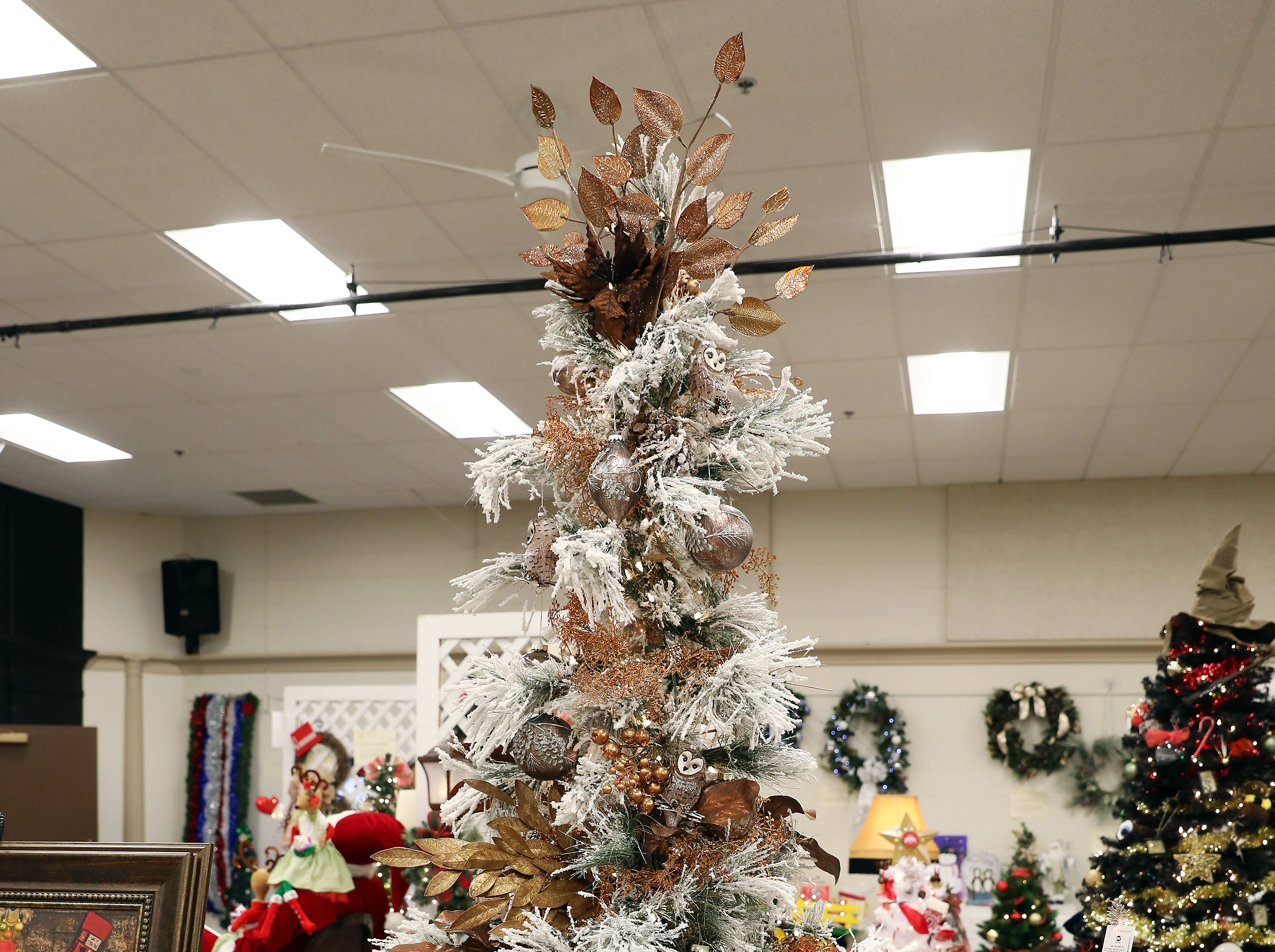 2045:00 PMThorne, Plumbing, Heating and Air ConditioningLarge TreeMerry Christmas!7.5' Flocked Bear Mountain tree elegantly decorated with glass owls, ornaments and shades of copper.Entry is incentive.