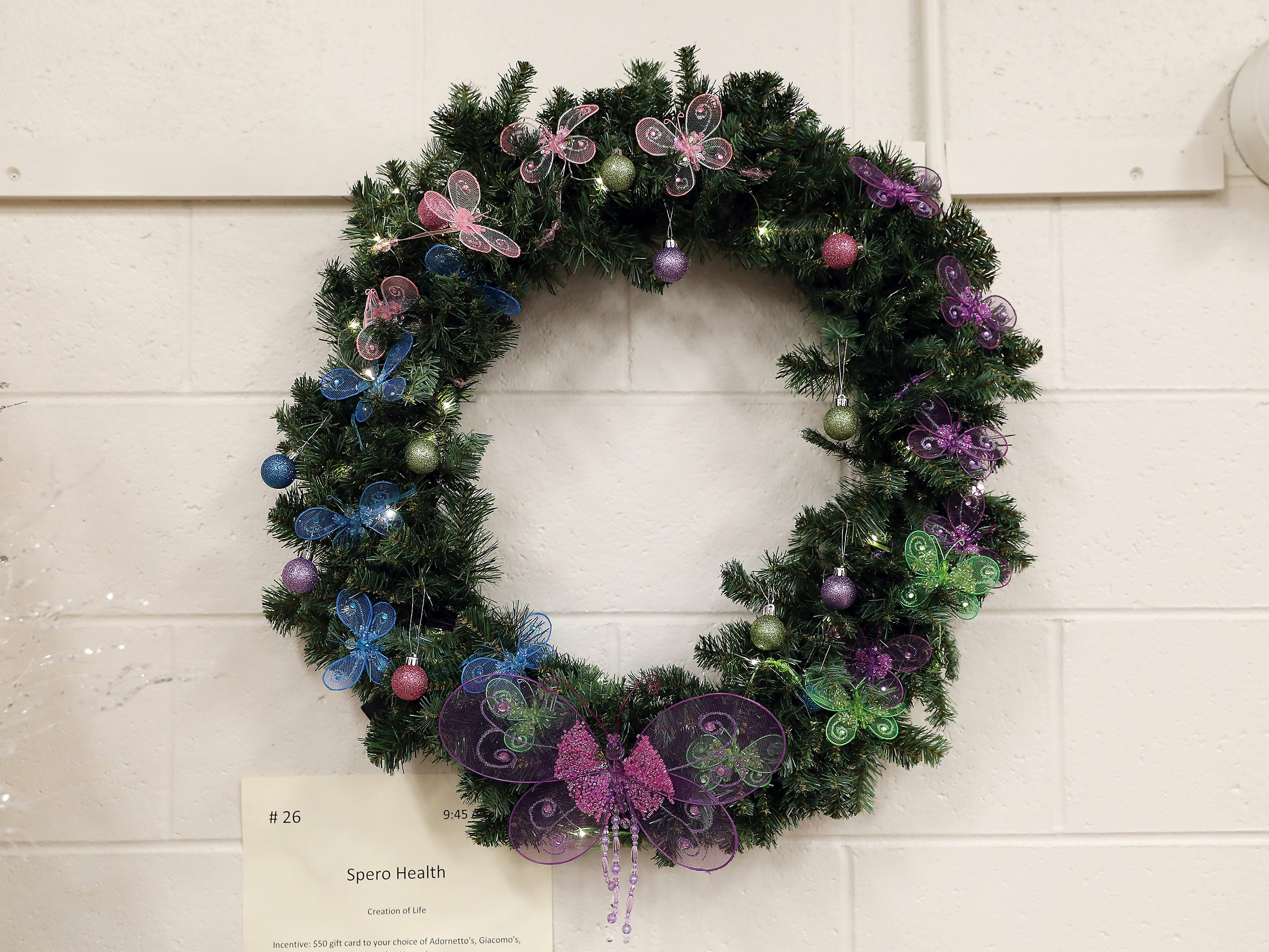 26	9:45 AM	Spero Health	Wreath	Creation of Life	This Christmas wreath will be sure to brighten your holiday season with lights, purple and pink butterflies with assorted Christmas bulbs.		$50 gift card to your choice of Adornetto's, Giacomo's, Old Market House Inn.