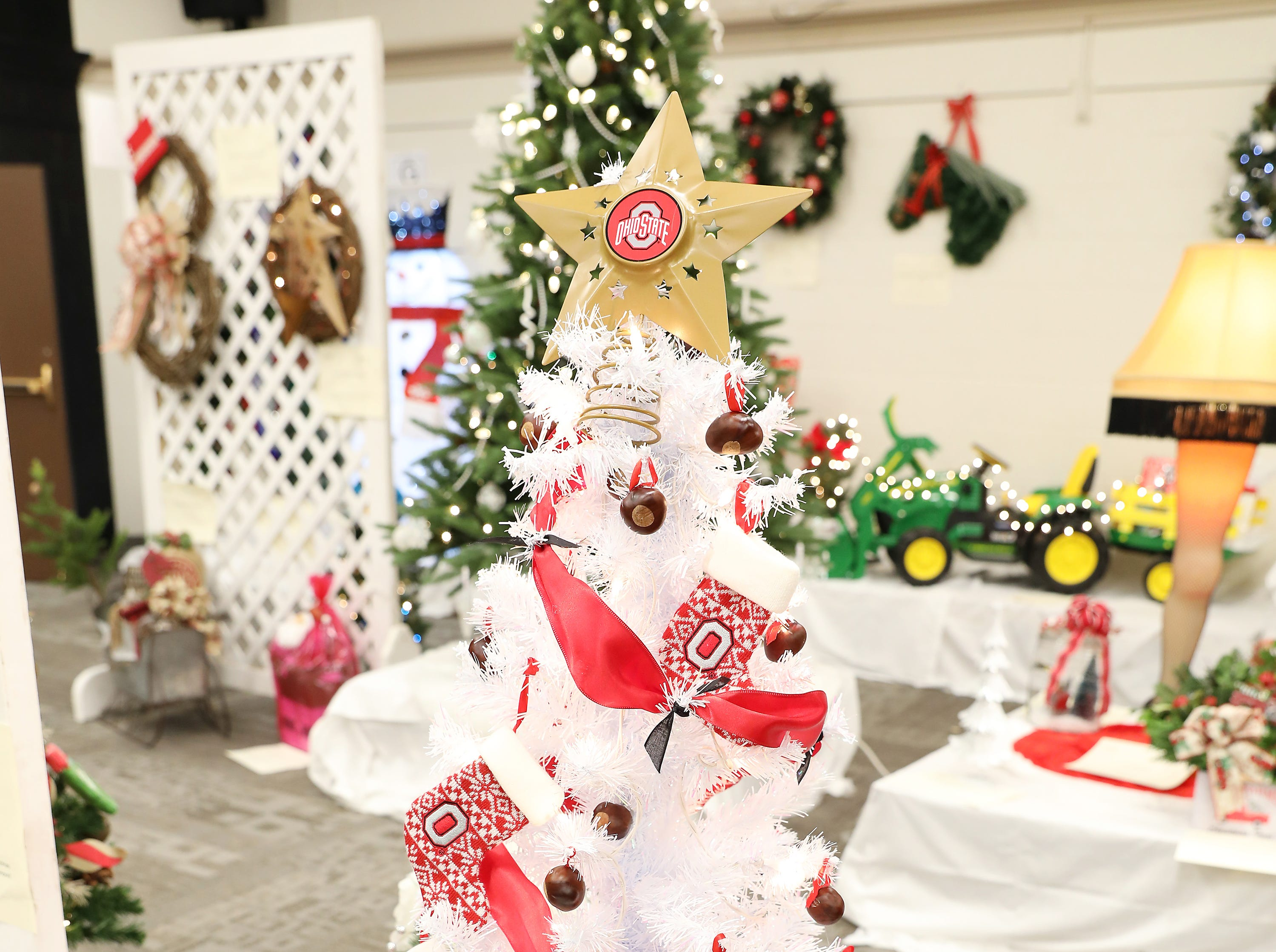 85	12:30 PM	Lepi & Associates Real Estate Services	Medium Tree	An Ohio State Buckeye Christmas	Scarlet and grey buckeye tree with buckeye ornaments, buckeye tree skirt and an Ohio State Star topper		$100 gift card to Adornettos.