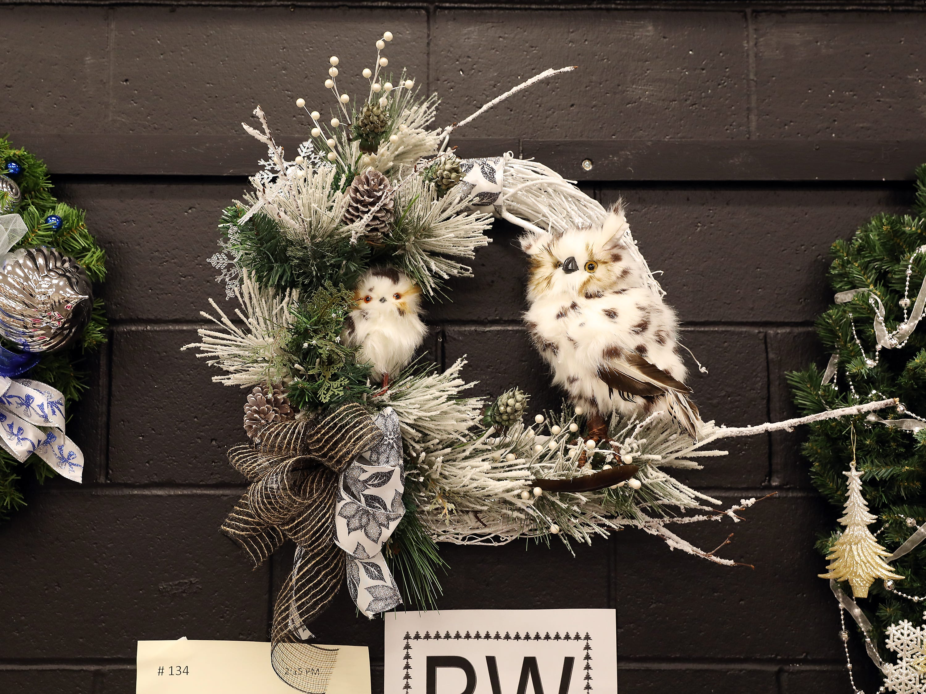 134	2:15 PM	McLain, Hill, Rugg and Assoc.	Wreath	The Wise Old Owl!	Christmas wreath		Gift cards, blanket, children's books and wood shelf.