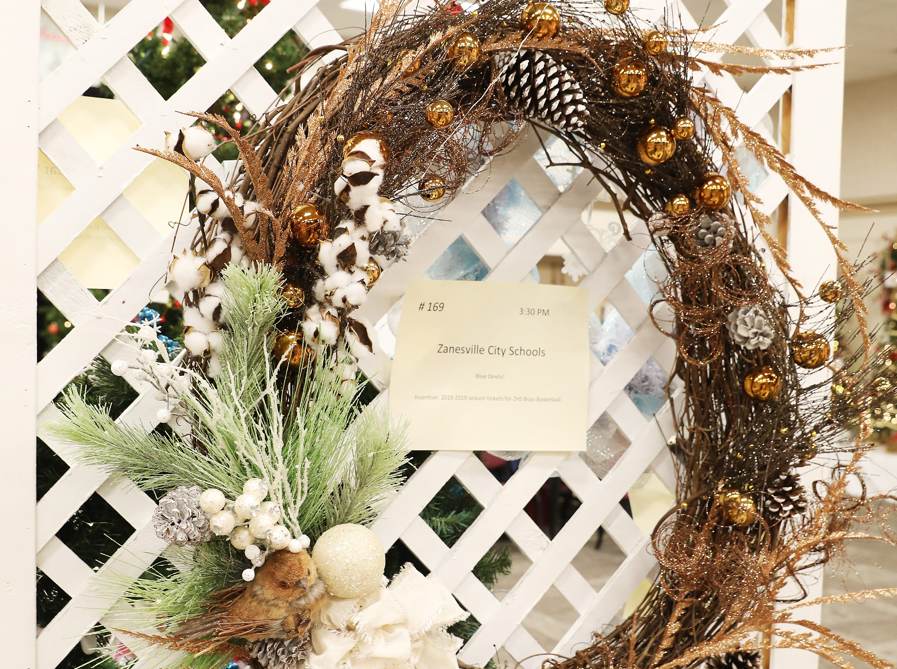 """1693:30 PMZanesville City SchoolsWreathBlue Devils! 30"""" Grapevine wreath adorned with copper highlights, white pinecones and a small bird.2018-2019 season tickets for ZHS Boys Basketball."""