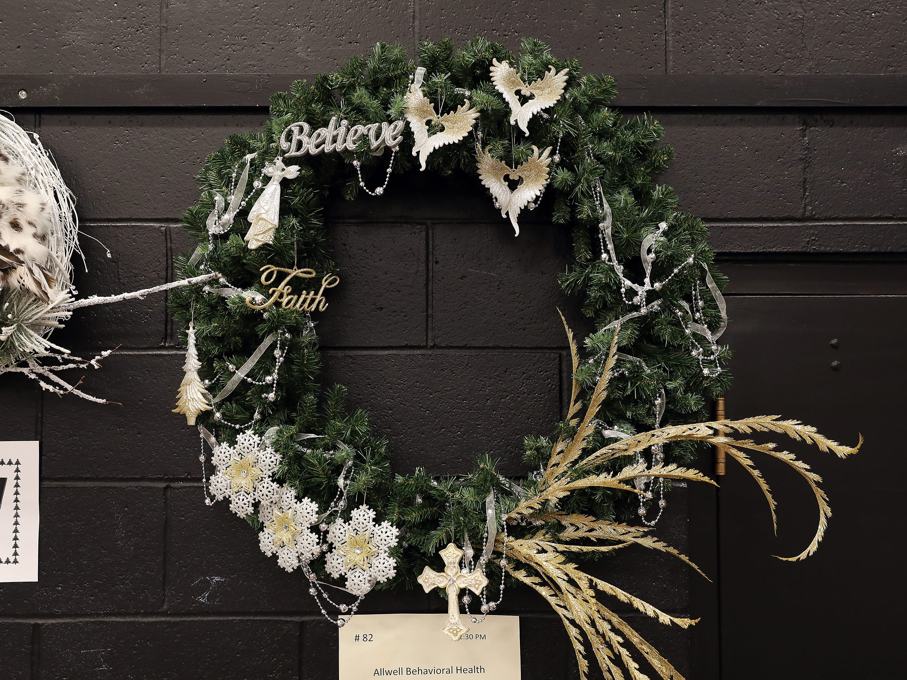 "82	12:30 PM	Allwell Behavioral Health Services	Wreath	Believe	36"" wreath with silver and gold mix ornaments, angel, angel wings and cross.		$50 gift card to HoneyBaked Ham."