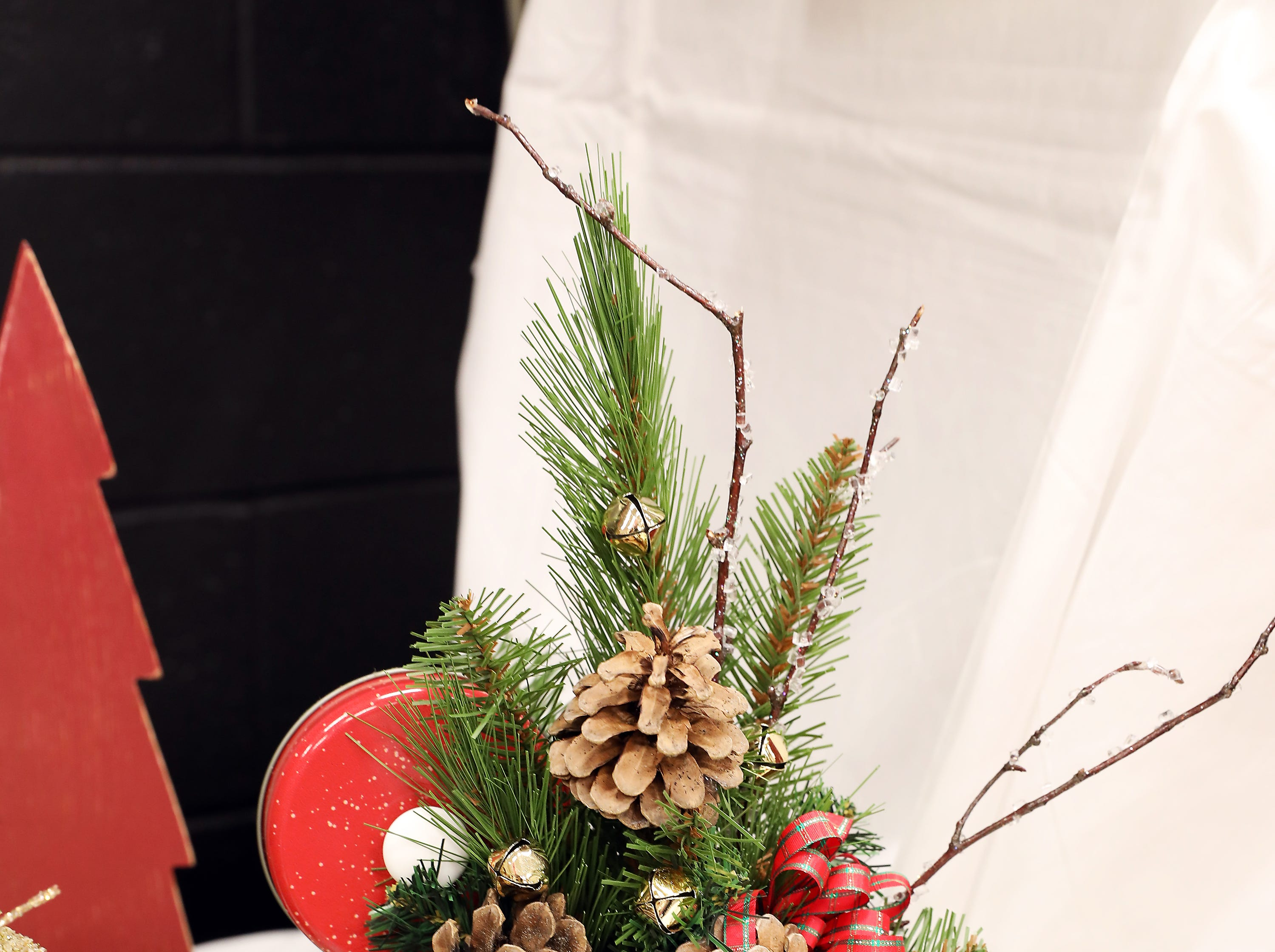 """1673:30 PMTrikes by RodneyCenterpieceHome for the Holidays20"""" tall Home for the Holidays Christmas tin filled with tall pine, iced branches, pine cones, jingle bells and red ribbon.$100 gift card to Trikes by Rodney and a Trikes by Rodney sweatshirt."""