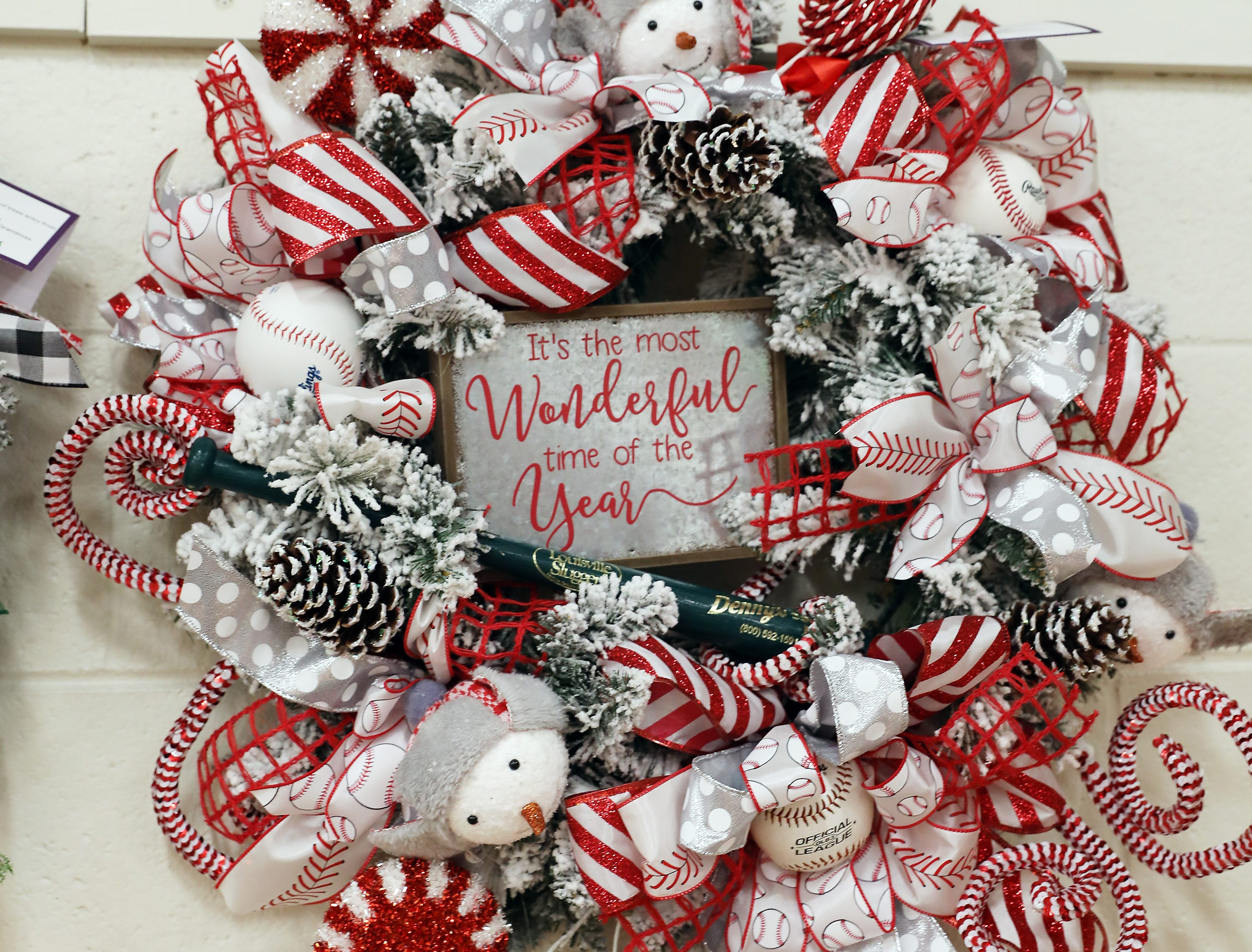 1854:15 PMDenny'sWreathGrand Slam ChristmasA winter theme wreath decorated with snow covered pine cones, snowman, baseballs and baseball themed ribbon.One free Grand Slam a week for one year!