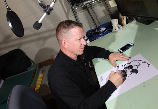 Kurt Dreier works on a caricature in his studio south of Zanesville. In addition to his caricatures, Dreier teaches at Maysville High School, and hosts a video podcast on his Facebook page.