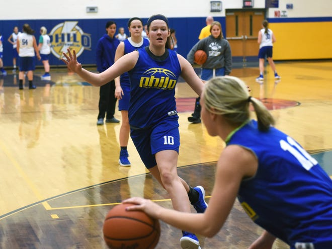 Philo juniors Bethany Colling, left, and Katie Shreve participate in a defensive drill during Tuesday's practice at The Power Plant. Colling, a 6-2 forward, is one of five returning letterwinners for the Electrics.