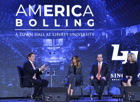Eric Bolling (left) speaks as first lady Melania Trump participates in a town hall on opioids at Liberty University in Lynchburg, Virginia, on Nov. 28.