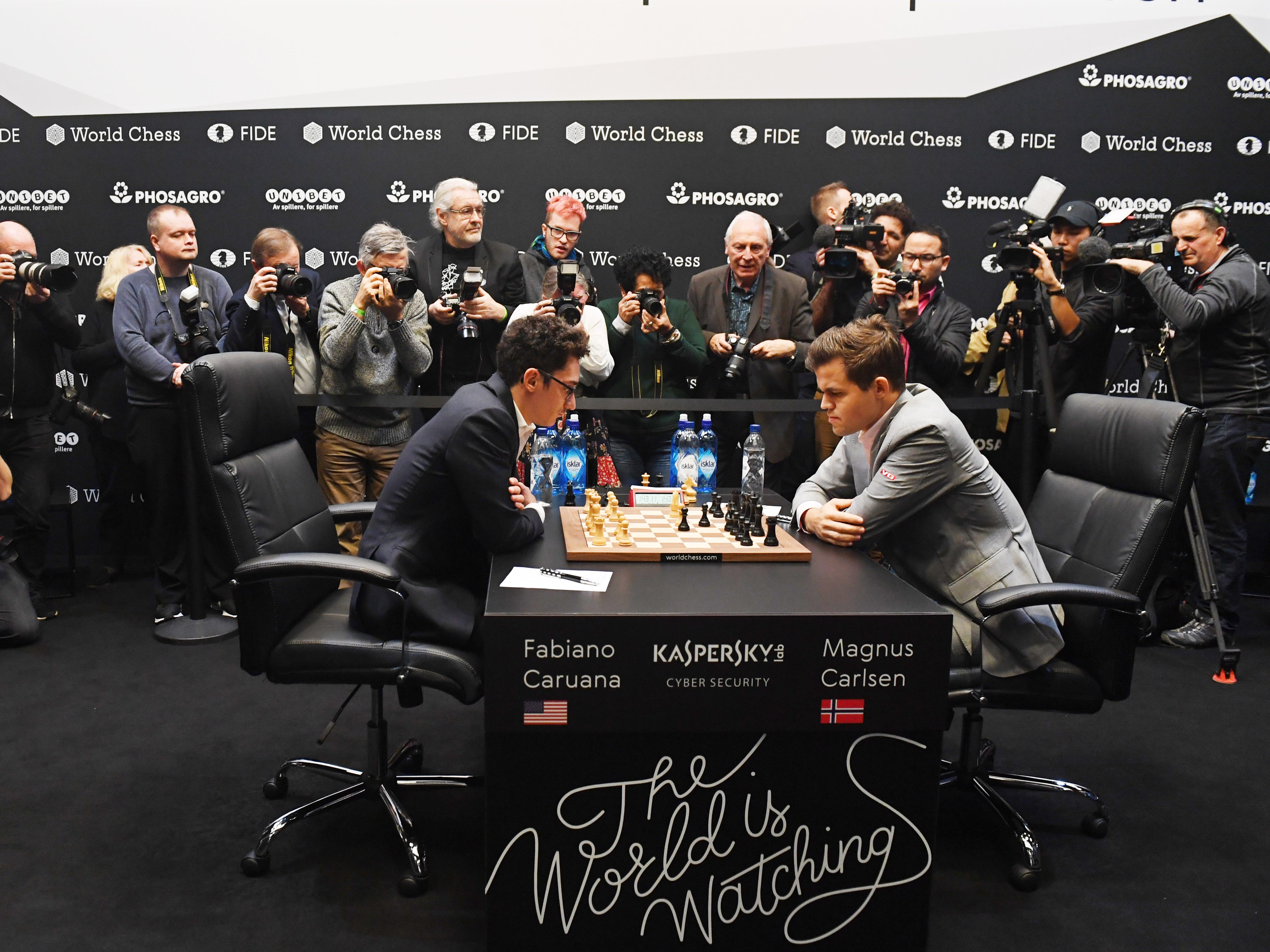 Reigning chess world champion Magnus Carlsen plays against American challenger Fabiano Caruana during round 12 of the World Chess Championship, Nov. 26, 2018.