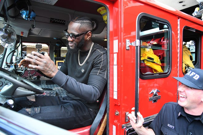 Deontay Wilder sits in the drivers seat of a fire truck on his visit to Los Angeles County Fire Department Station 3 during the lead up to his heavyweight fight against Tyson Fury Saturday at the The Forum.