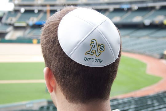 Orthodox Jews wear yarmulkes, like this baseball-themed one.