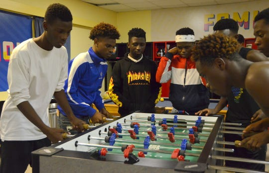 The reVision FC game room is a second home for the players, who say they have become a family.