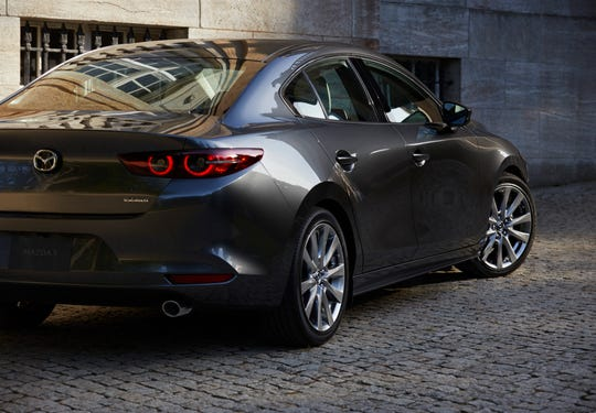 The redesigned Mazda3, seen here in a corporate photo shoot, debuted at an event tied to the Los Angeles Auto Show in November 2018.