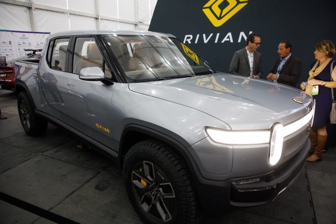 epa07193995 The Rivian R1T all-electric pickup truck is shown at the Automobility LA auto show in Los Angeles, California, USA, 27 November 2018. The show will feature more than 60 vehicle debuts.  EPA-EFE/EUGENE GARCIA ORG XMIT: EAG02