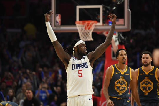 Montrezl Harrell celebrates the Clippers' 121-116 overtime win over the Warriors.
