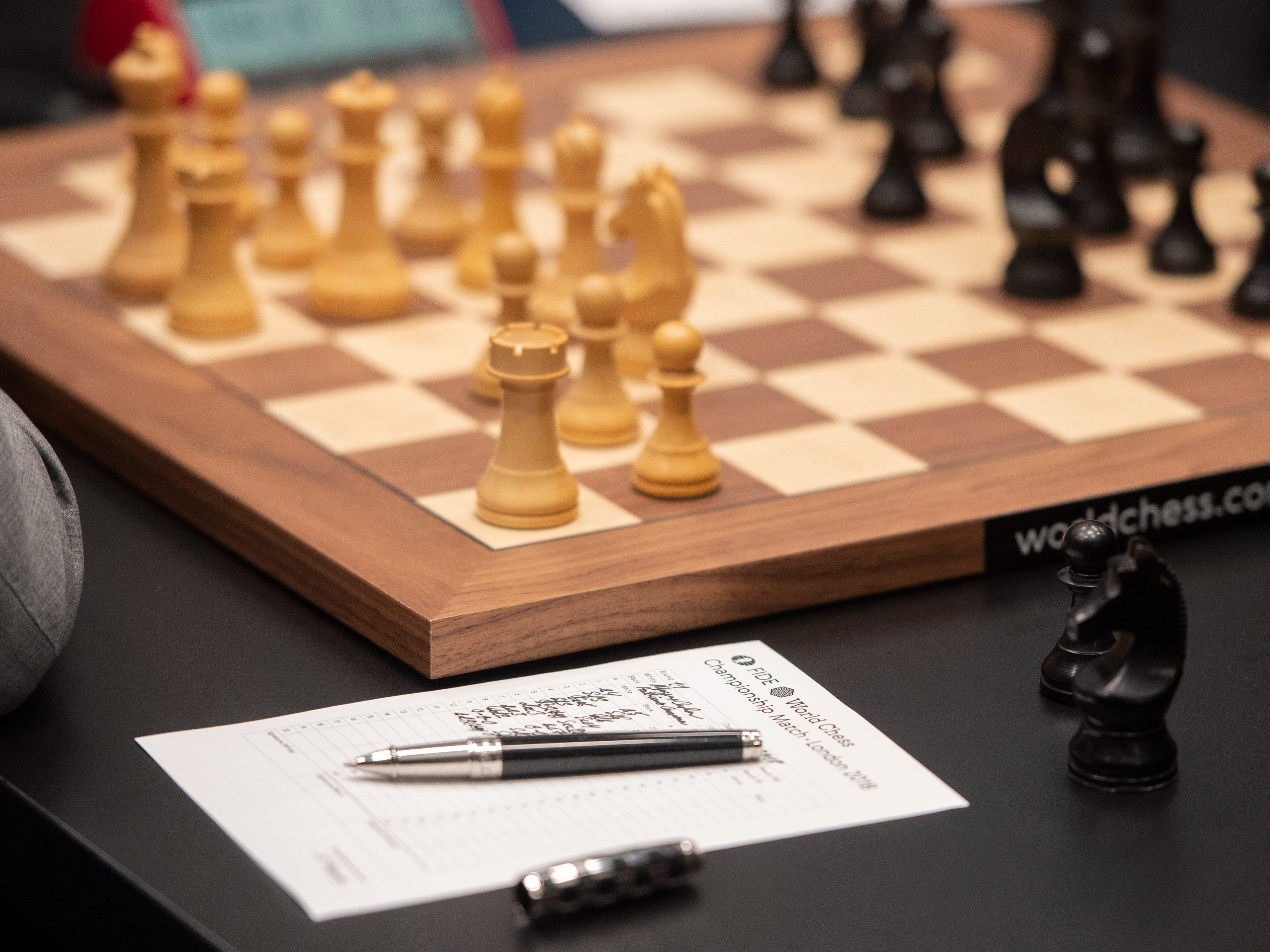 Reigning chess world champion Magnus Carlsen's notes are seen as he plays against American challenger Fabiano Caruana in their round 11 game during the World Chess Championship, Nov. 24, 2018, in London.